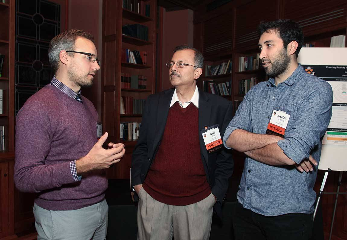Timothy Buschman, assistant professor of psychology and the Princeton Neuroscience Institute, talks with co-presenters Niraj Jha, a professor of electrical engineering and associate director for education, Andlinger Center for Energy and the Environment, and Arsalan Mosenia, a graduate student in electrical engineering. Jha and Mosenia presented work on enhancing security of implantable and wearable medical devices, and more broadly, the Internet of Things.