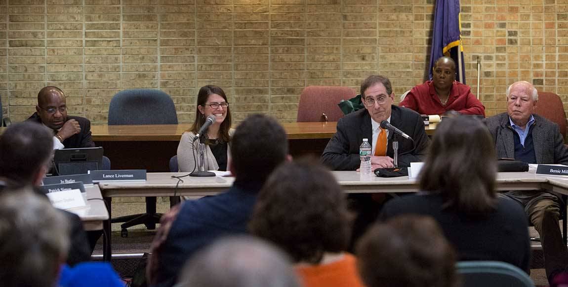 From left: Princeton Council President Lance Liverman, Mayor Liz Lempert and Council member Bernie Miller listen to Eisgruber during the public meeting at the Monument Hall municipal building.