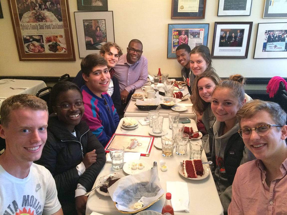 Wallace Best, professor of religion and African American studies (left rear), and students in his course 'African American Religious History' take a lunch break at the historic Sylvia's during a walking tour of Harlem. Senior Adam Hudnut-Beumler (bottom right) called the trip 'an educational highlight of my time at Princeton.'
