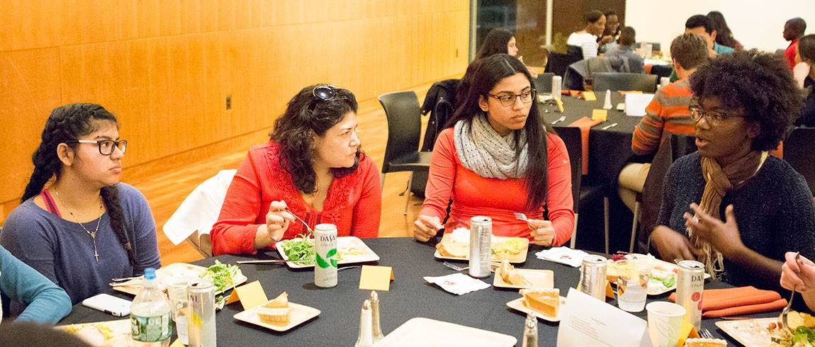 Scholars Institute Fellows Program (SIFP) students with Khristina Gonzalez at first-generation college students dinner