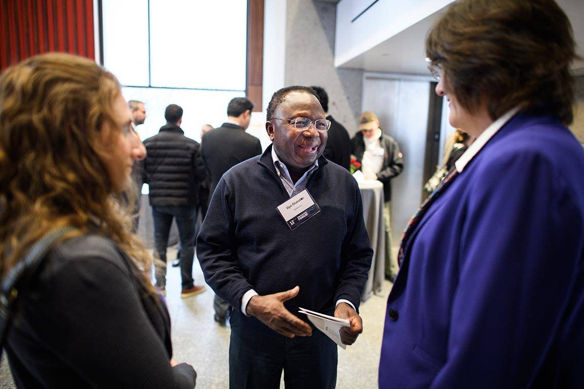 The Innovation Forum, held this year in Maeder Hall of the Andlinger Center for Energy and Environment, draws business draws leaders from a range of industries and offers networking opportunities. Oye Olukotun (center), chief executive officer of EpiGen Pharmaceuticals, spoke with other participants.
