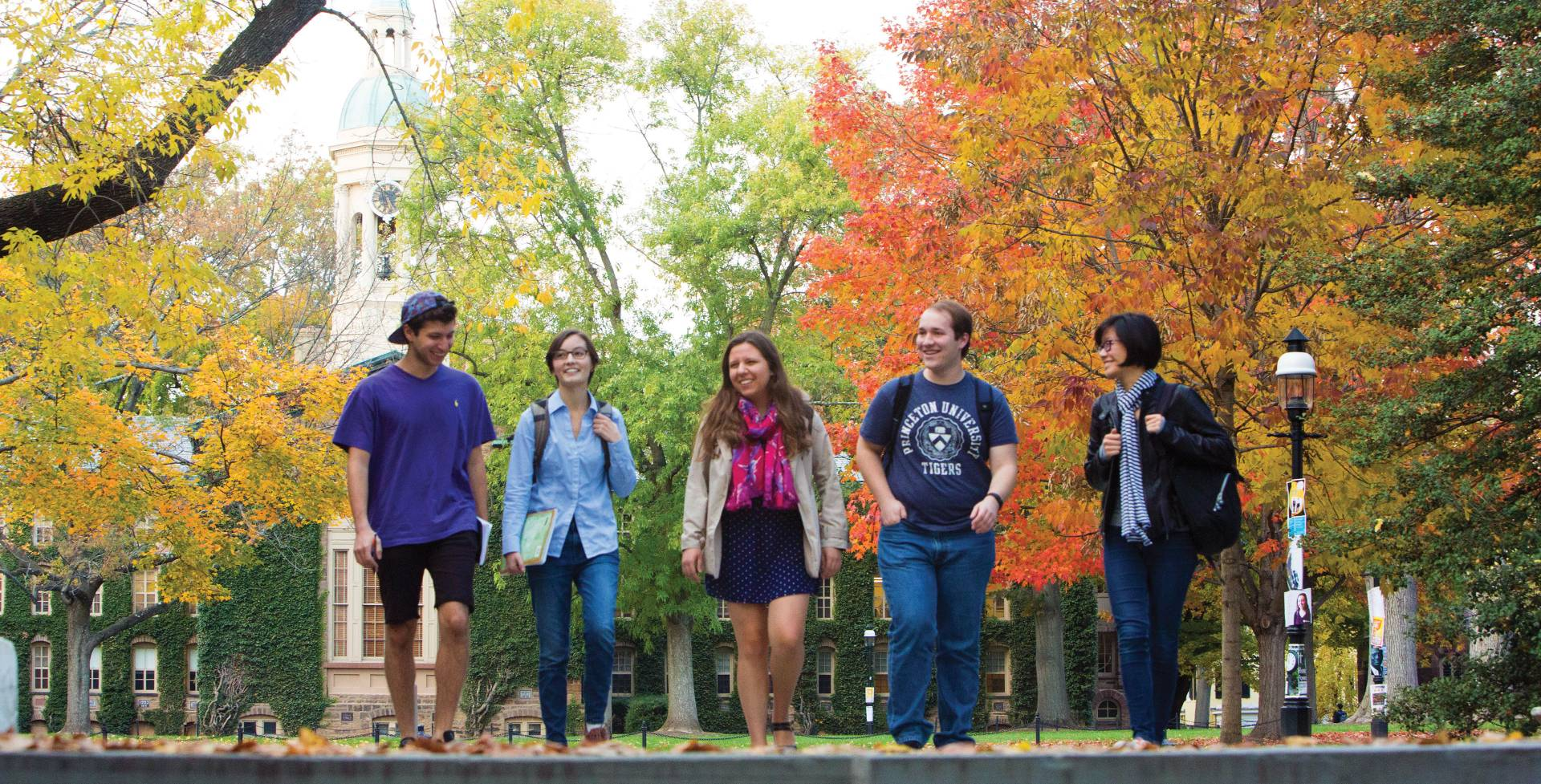 Students walking in a line away from Nassau Hall during Fall