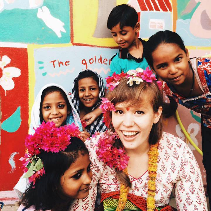 Student with children during her international internship
