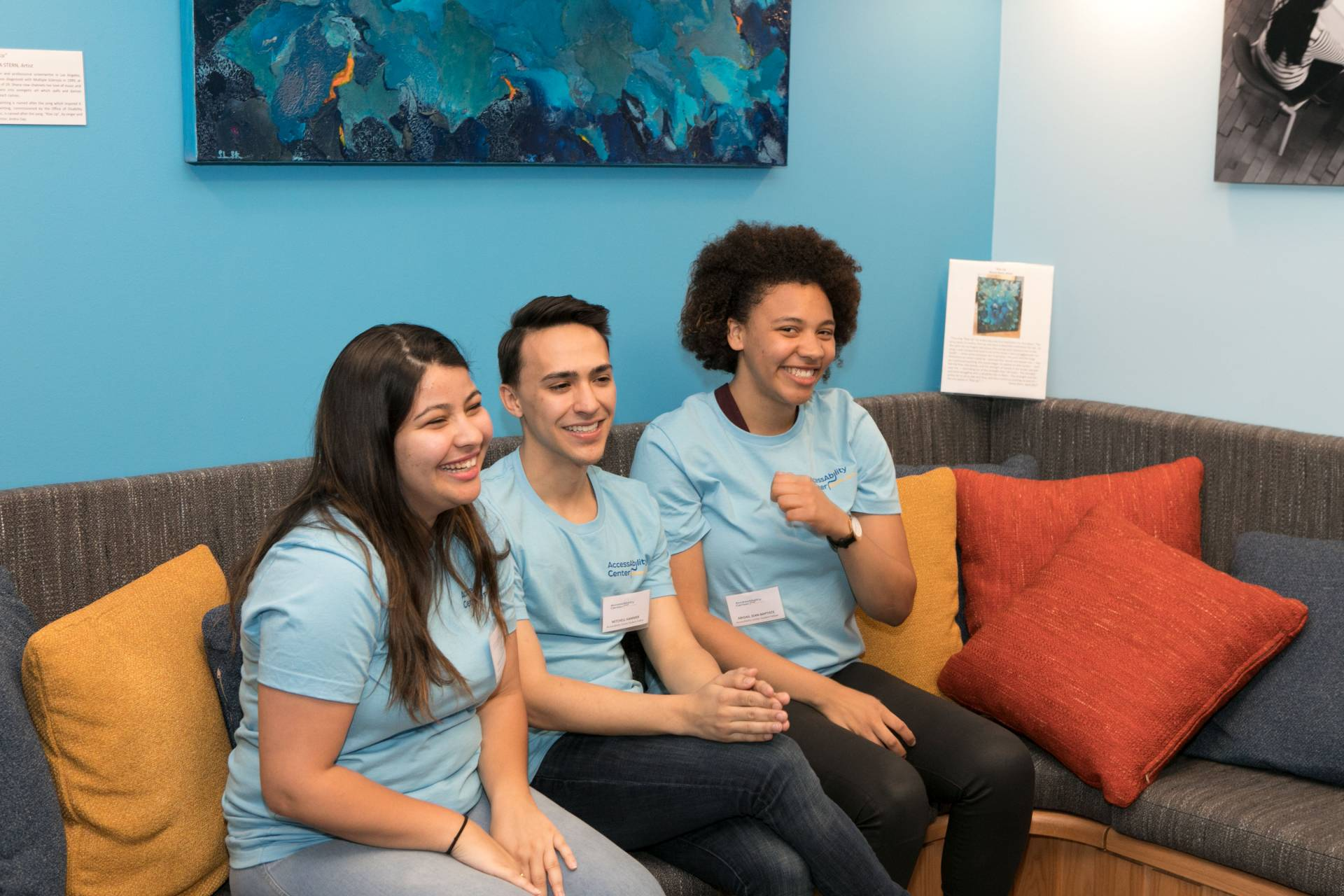 Office of Disability Services' student fellows, from left, Monica Magalhaes, Mitchell Hammer and Abby Jean-Baptiste sitting on couch