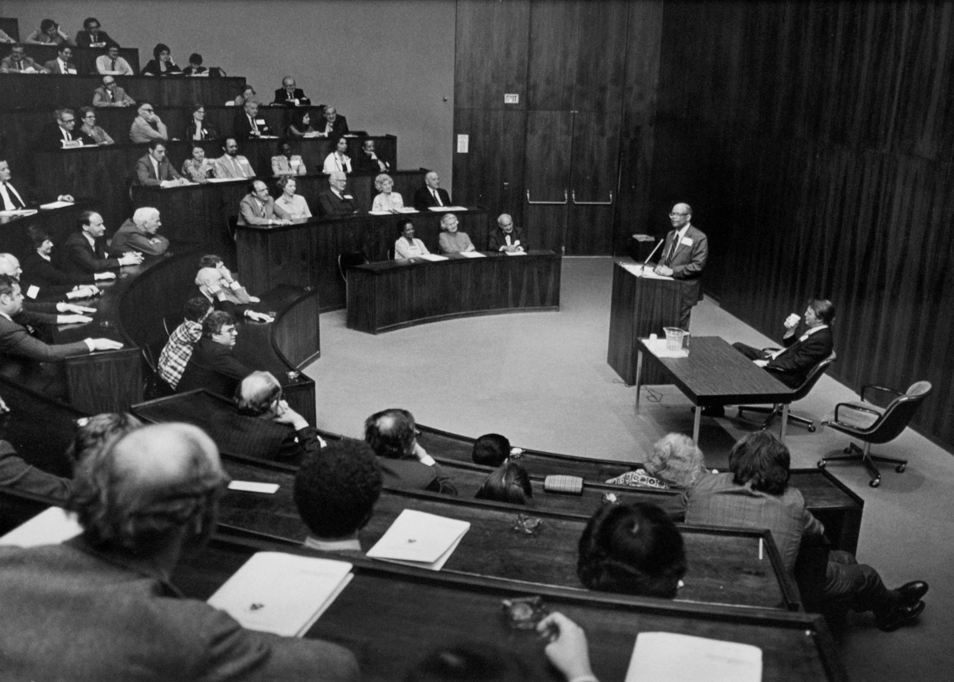 Sir Arthur Lewis giving lecture in auditorium at the Woodrow Wilson School in 1970s