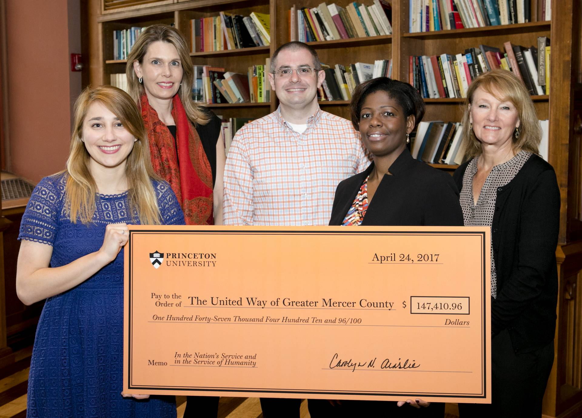 United Way and Princeton University staff holding donation check