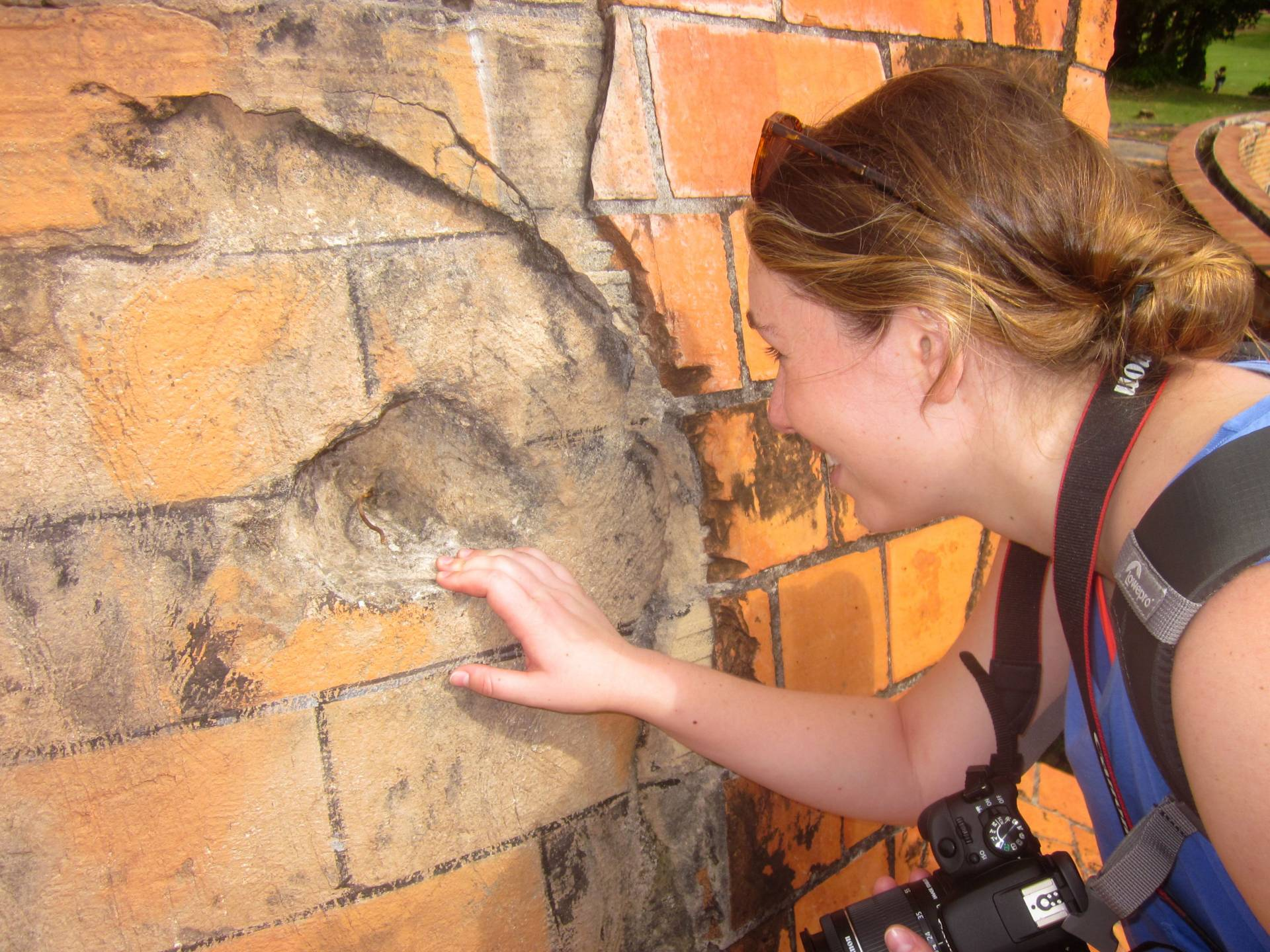 Isabella Douglas looking at reinforced concrete in Cuba