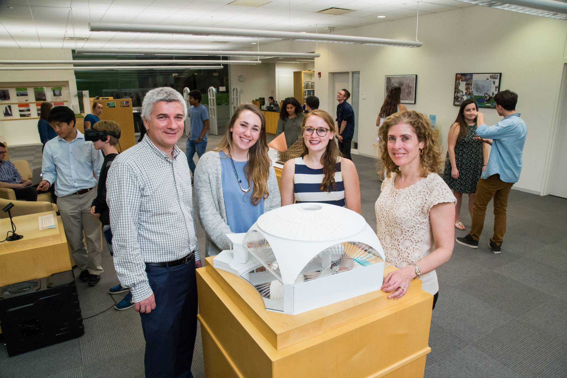 Isabella Douglas standing with architecture model and professors