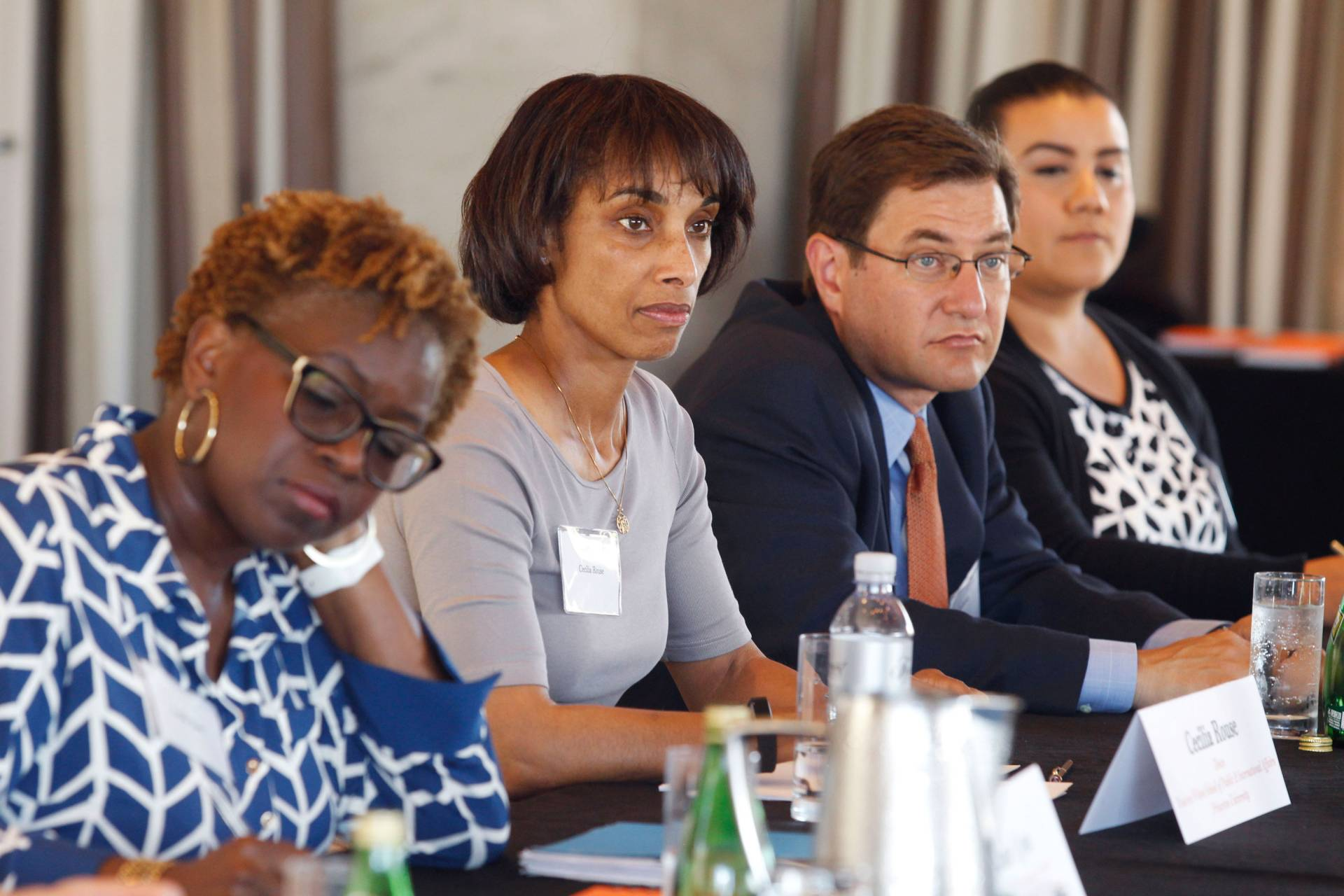 Cecilia Rouse sits at a table with others during a panel