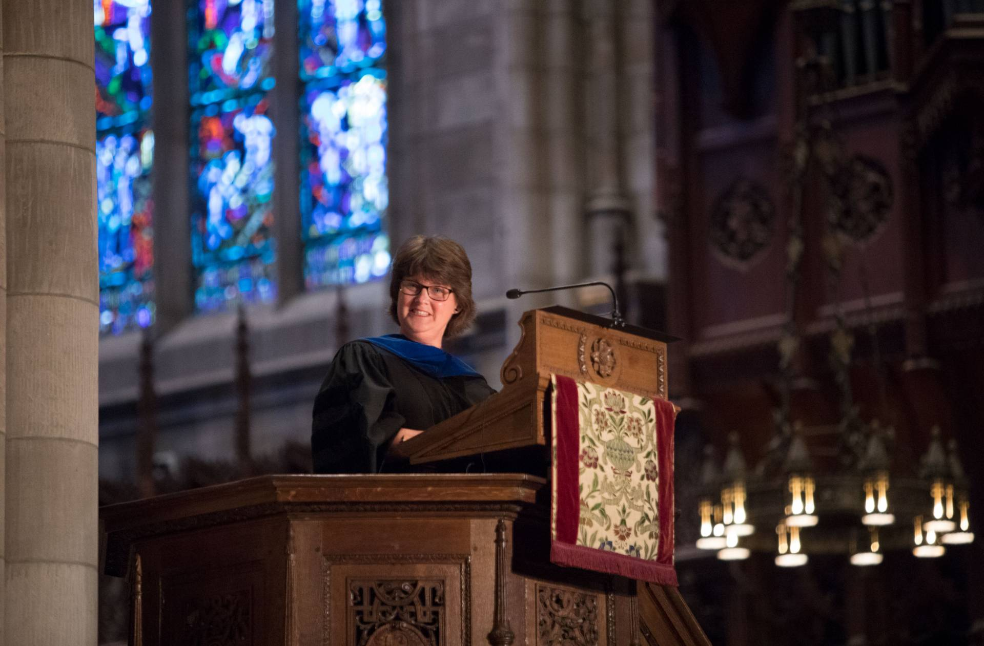 Anne Holton at podium during Baccalaureate 2017 ceremony