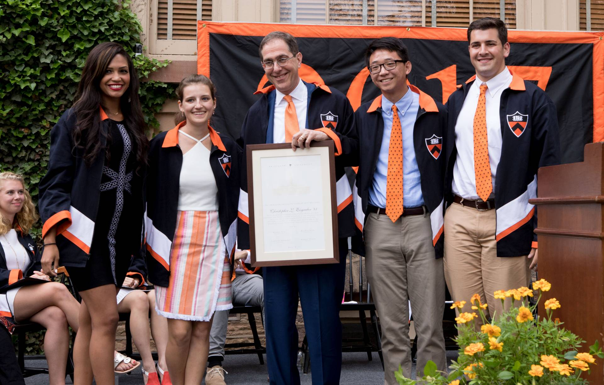 President Eisgruber standing with students after receiving Class Day 2017 jacket