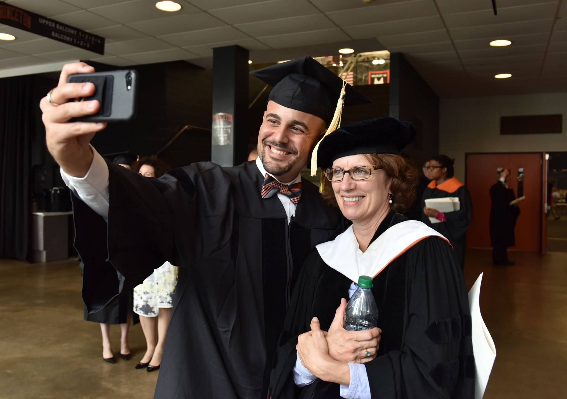 Student takes selfie with advisor