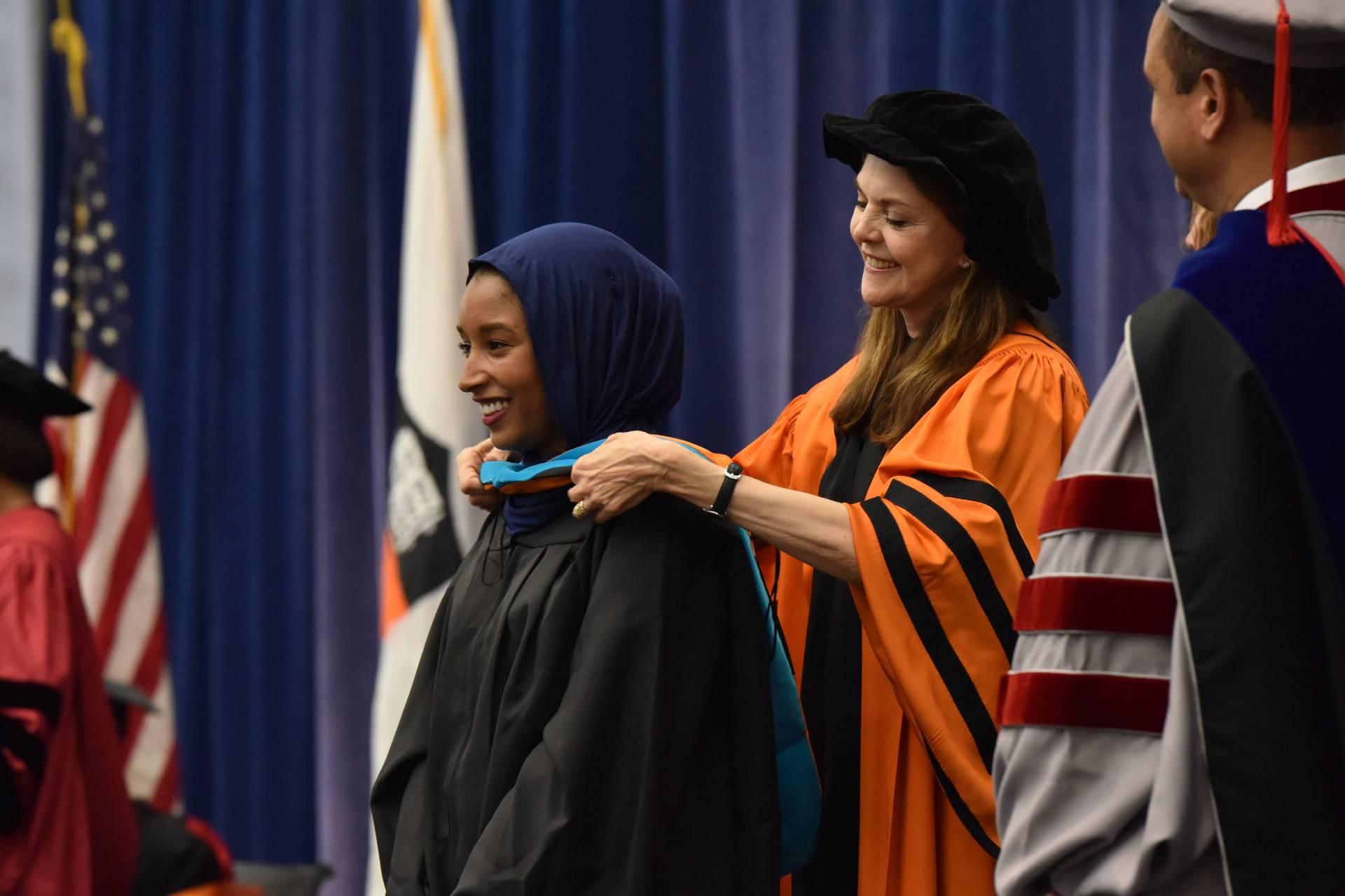 At Hooding, advanced-degree recipients celebrate hard, successful ...