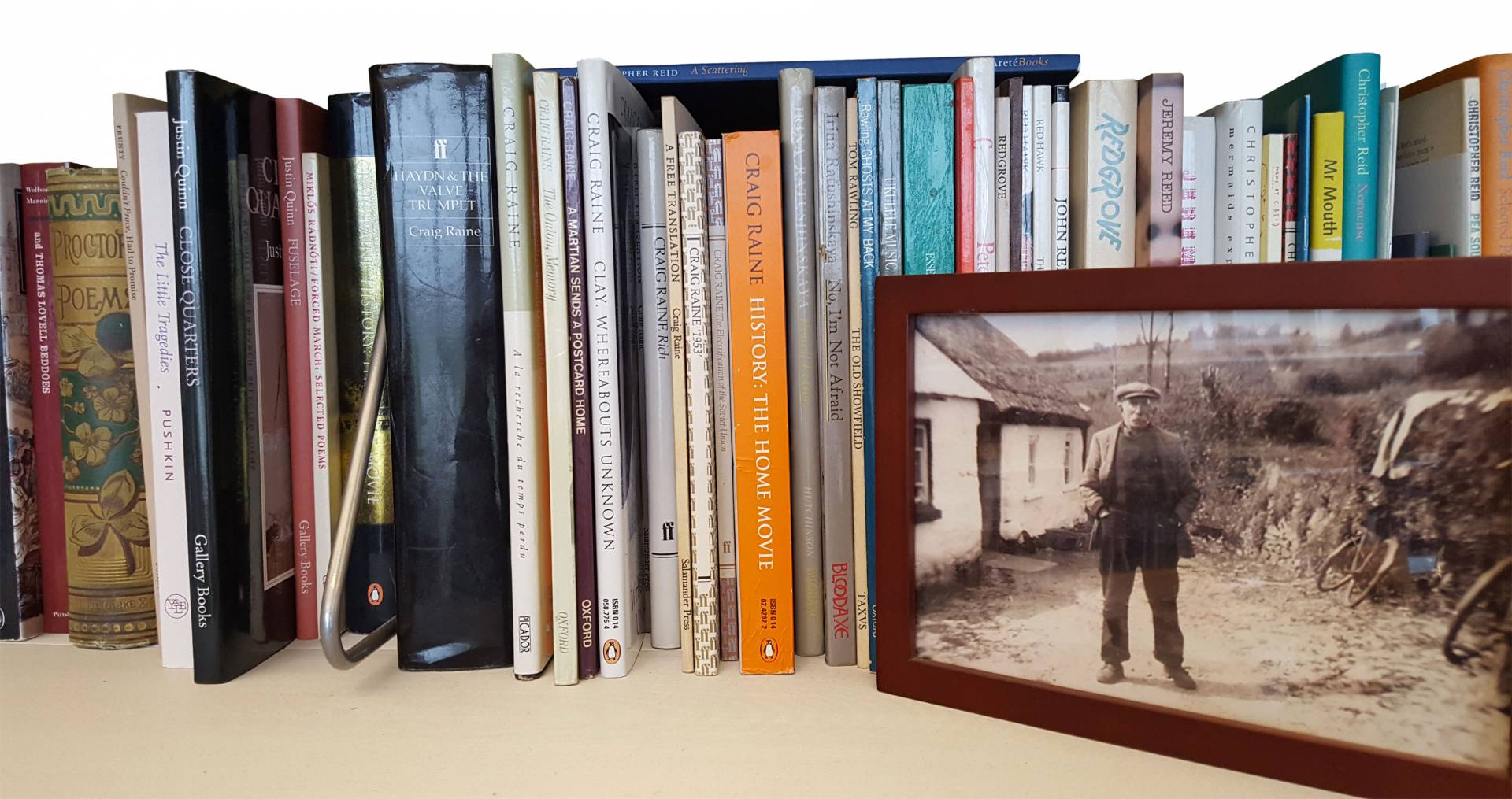 books on shelf in Paul Muldoon's office