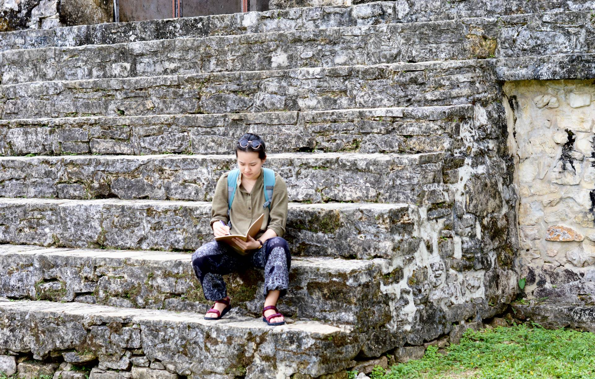 Crystal Wang sketching in the East Court of Palenque's Palace