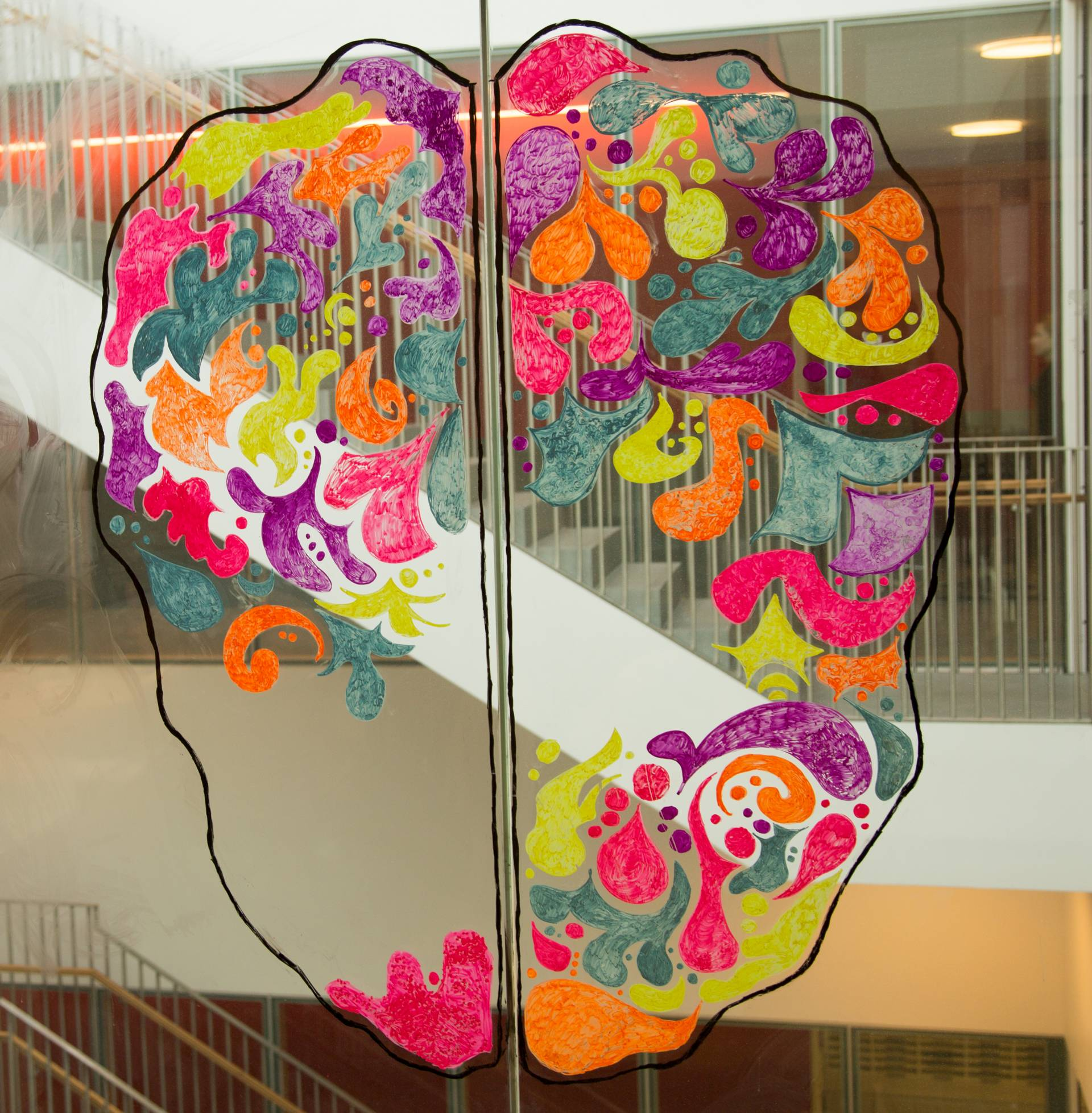 Mural on window of a colorful brain