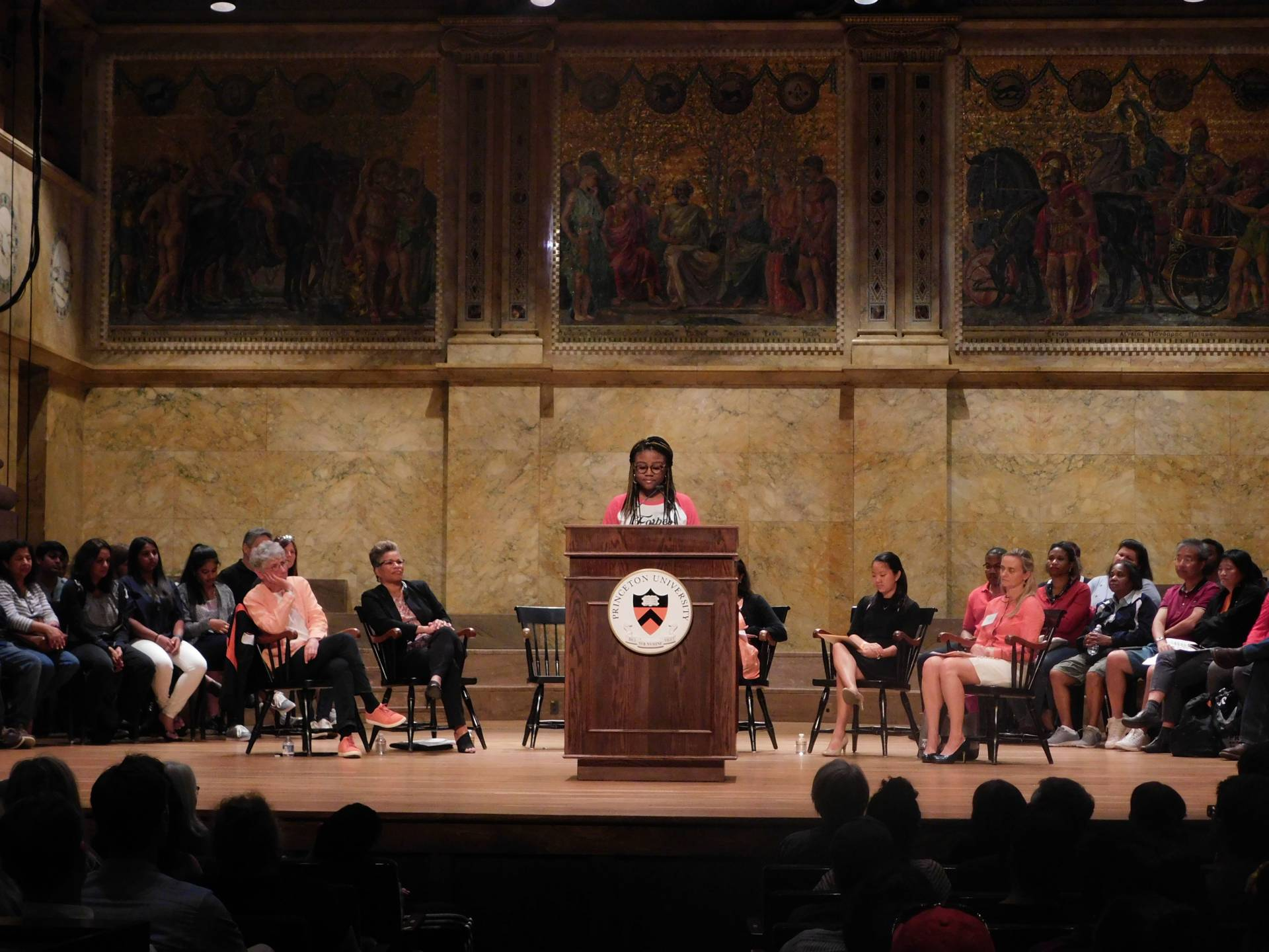 Myesha Jemison speaks to an audience family members during the Orientation welcoming program at Richardson Auditorium.