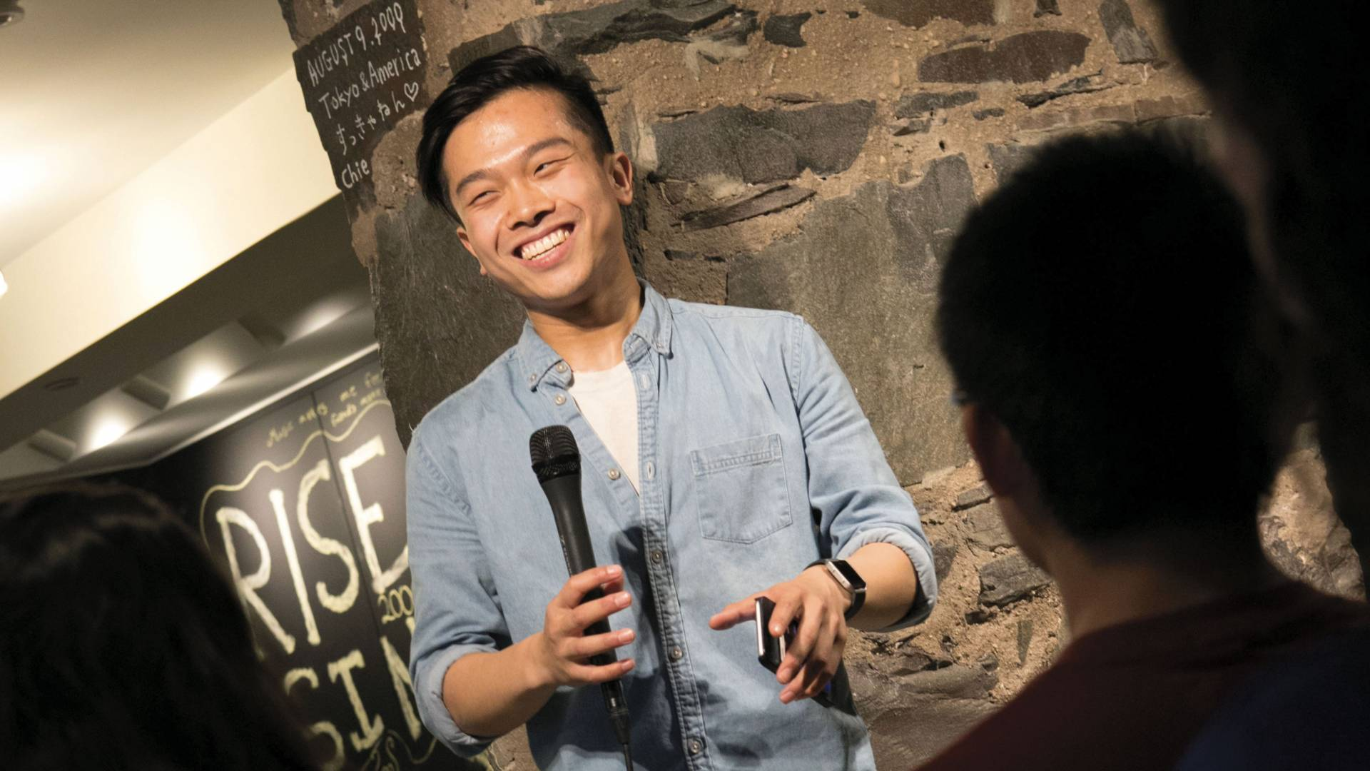 Edric Huang performing at slam poetry event