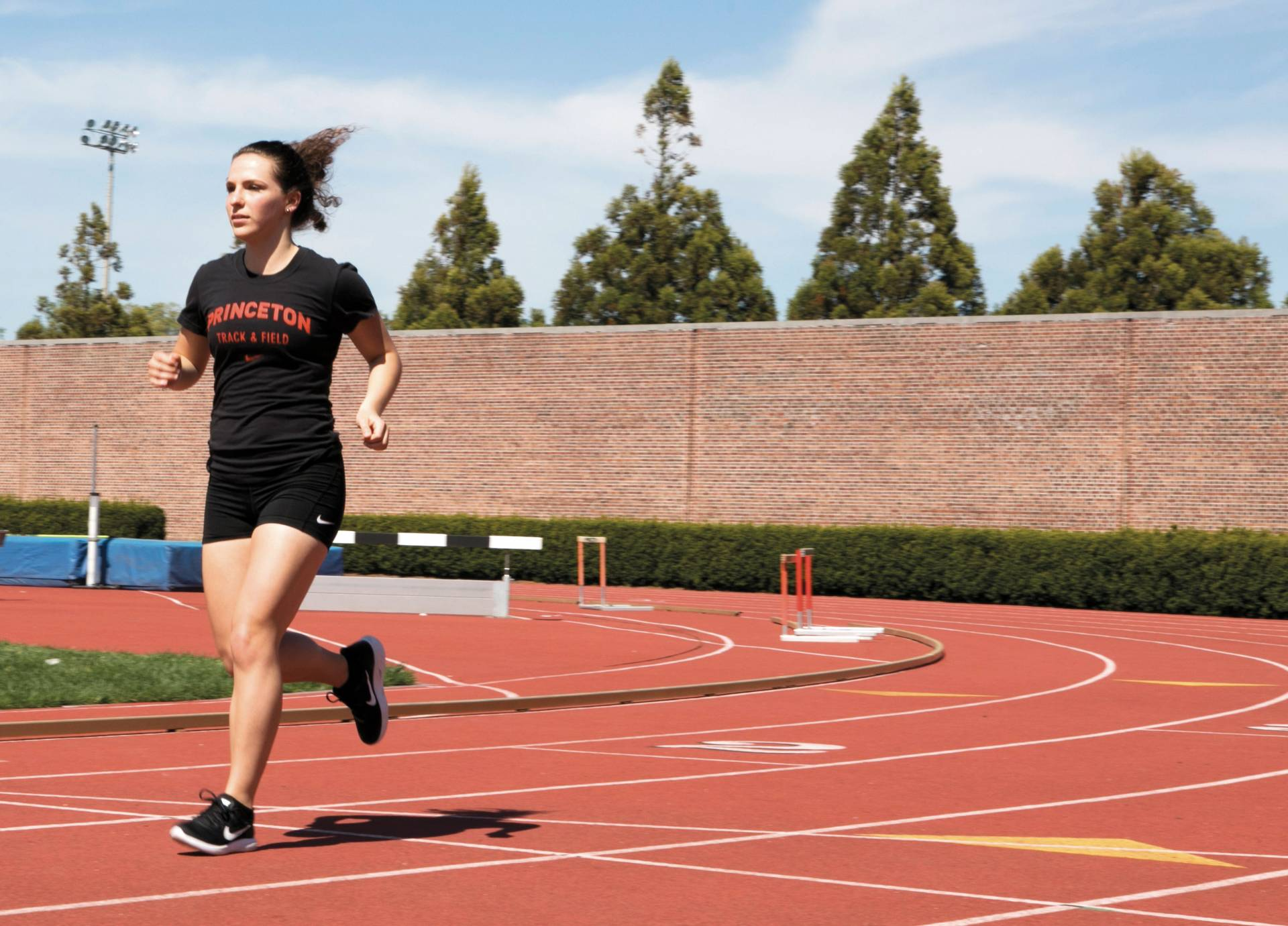 Melana Hammel running on outside track
