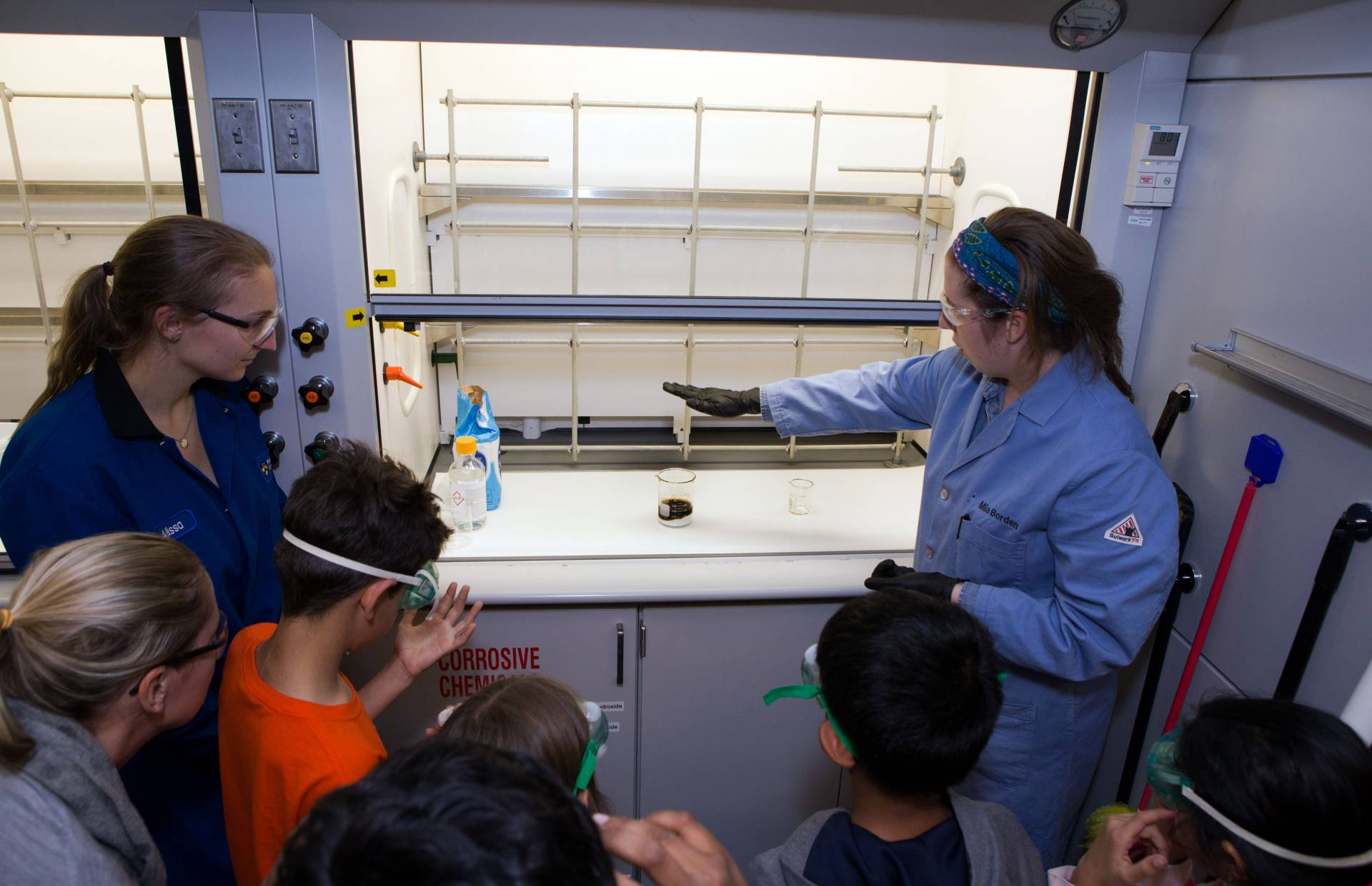 Graduate students show children how to make coal
