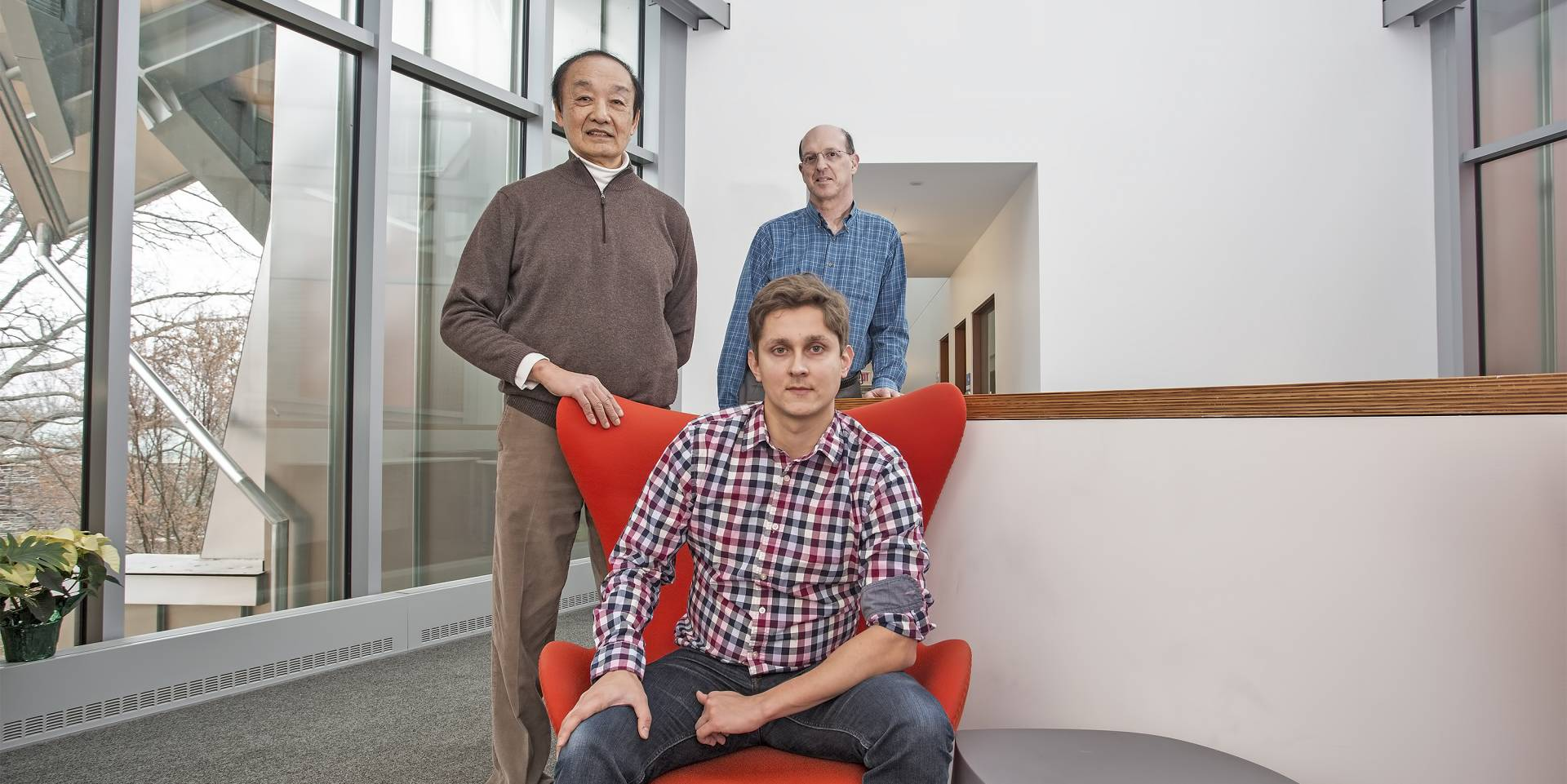 standing from left, Willliam Tang and Eliot Feibush, with Alexey Svyatkovskiy, seated.