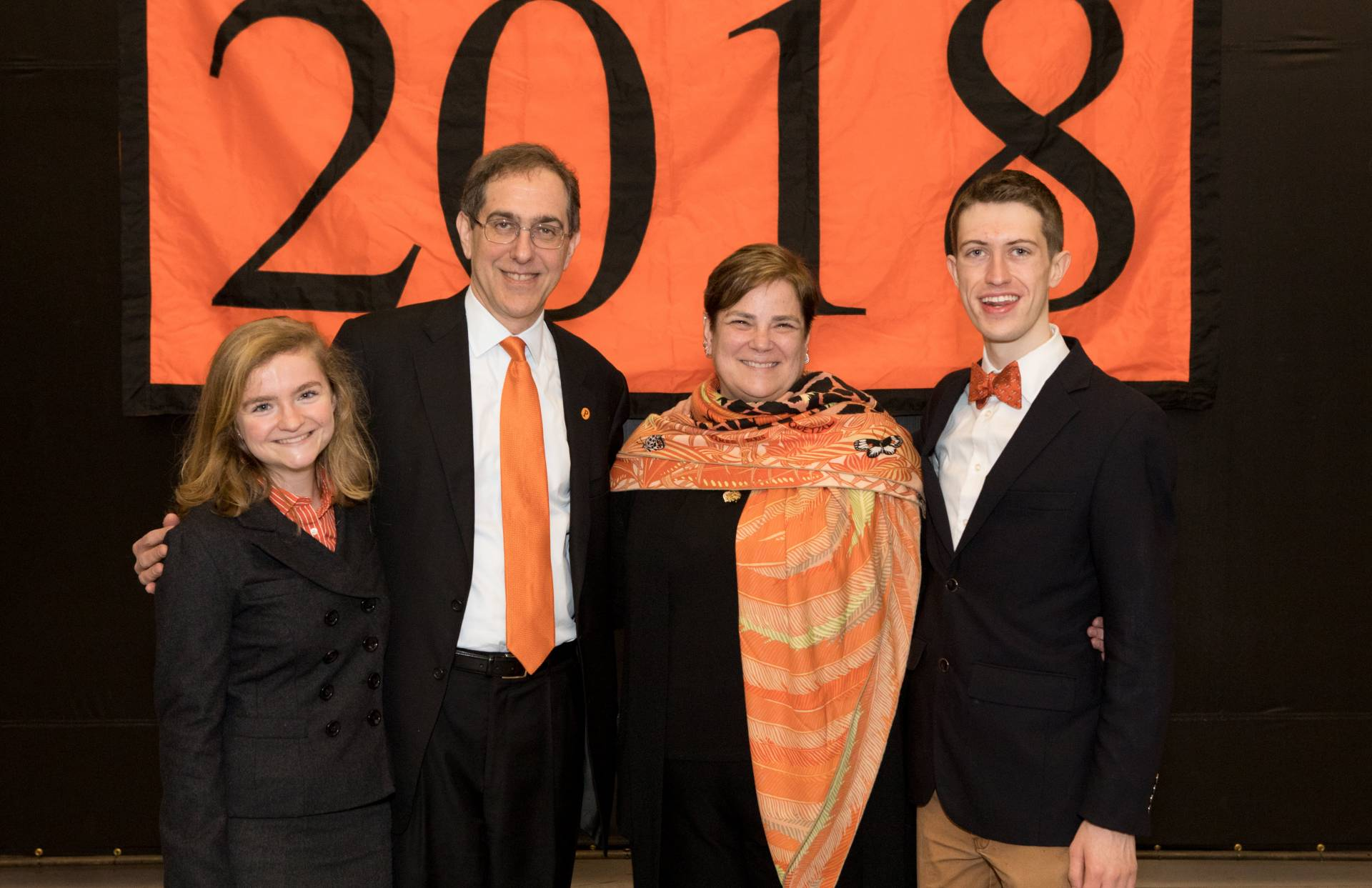 Pyne Prize winners stand in front of 2018 banner with Kathryn Hall and President Christopher L. Eisgruber