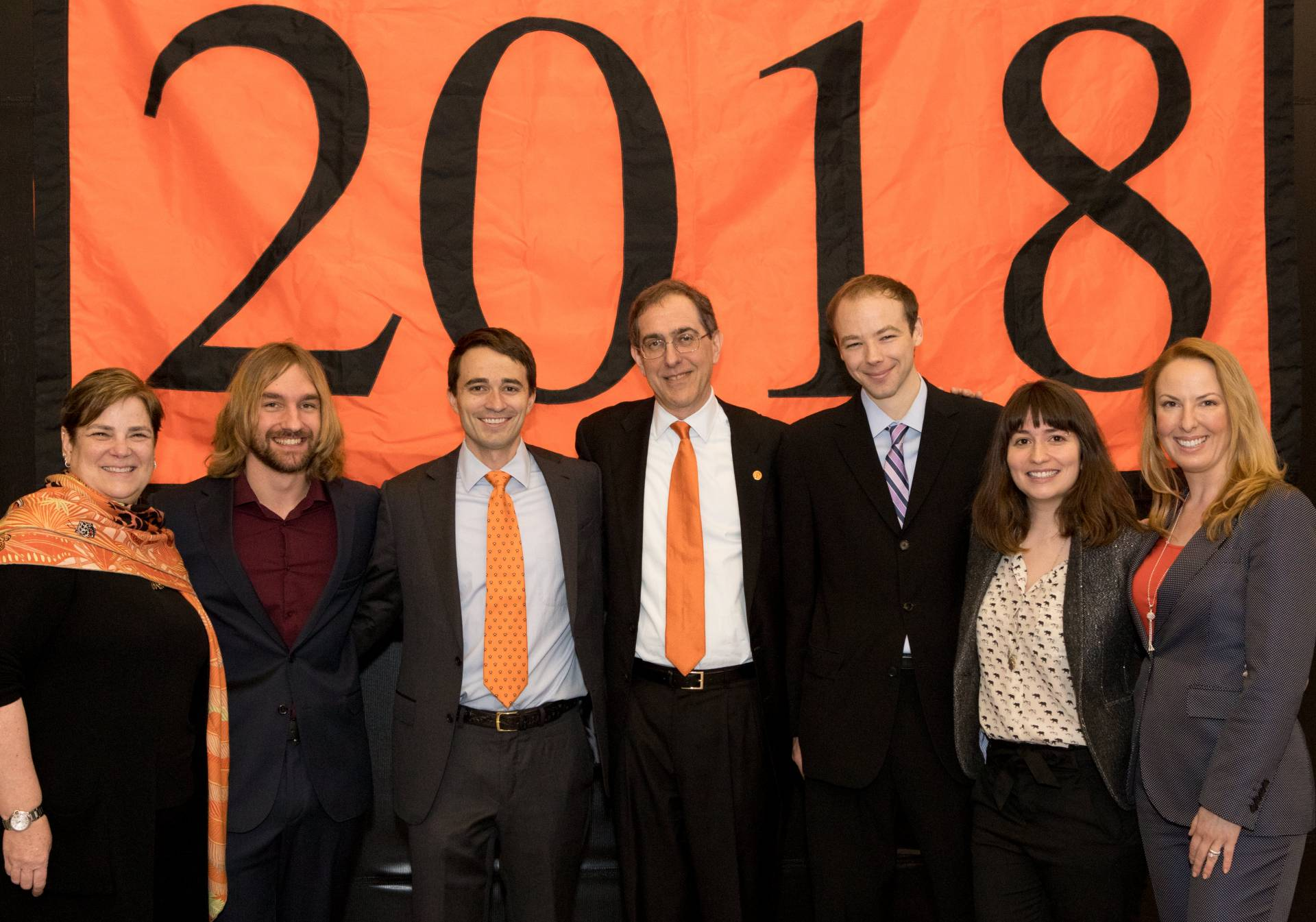 Jacobus Fellowship Winners in front of 2018 Banner