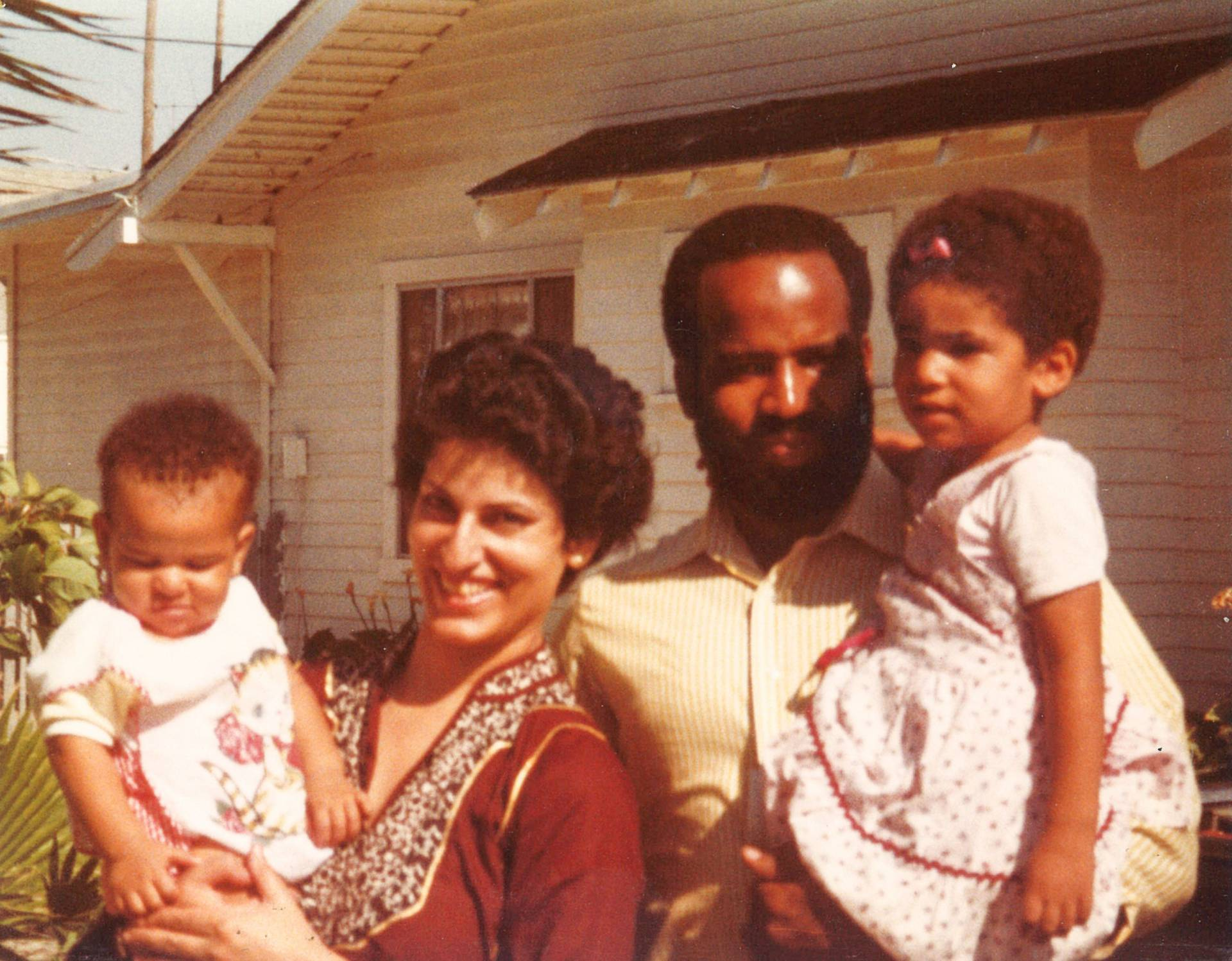 Ruha Benjamin as a young child with parents and sibling