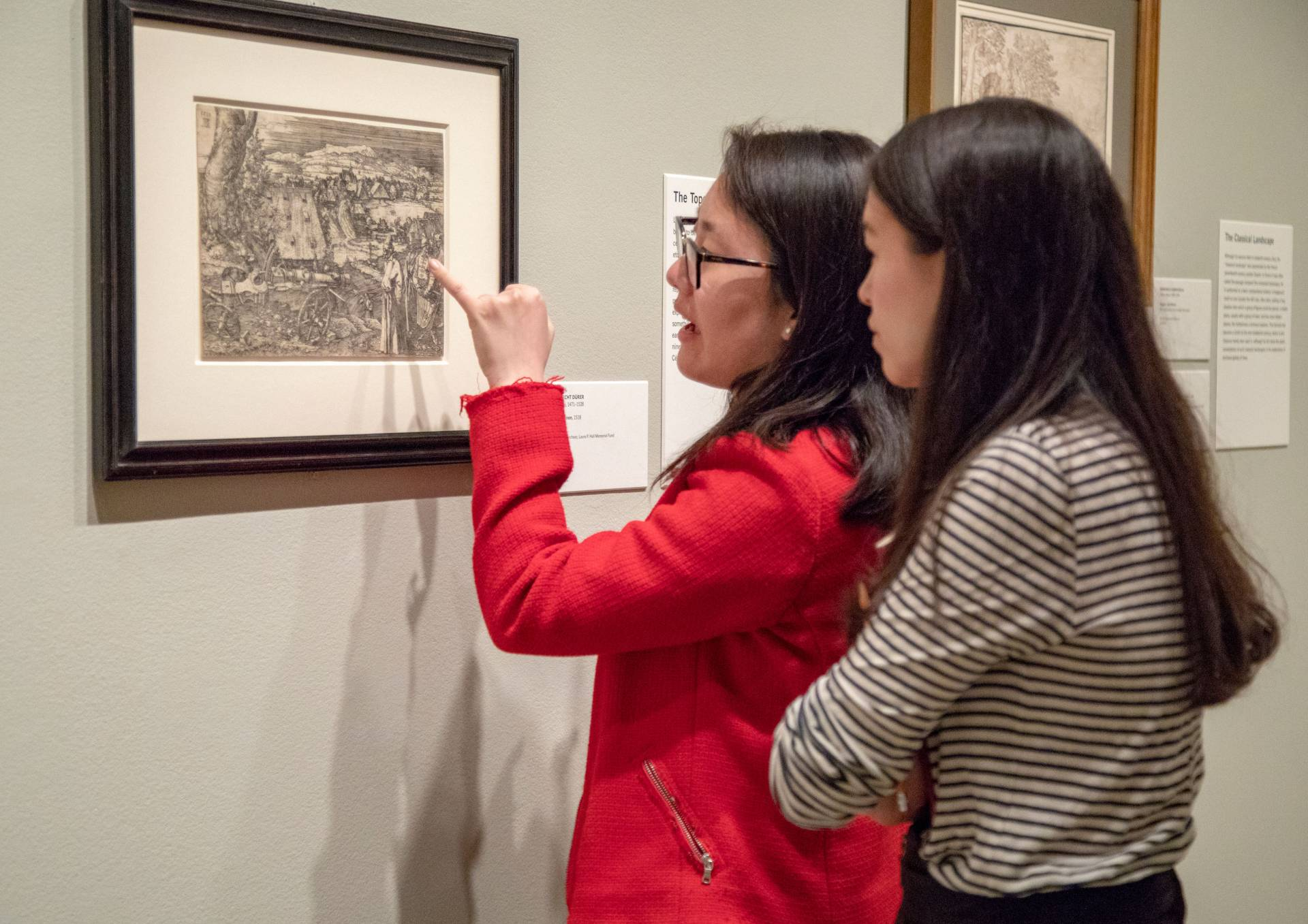 Sarah Cho and Sarah Rapoport look at work by Albrecht Durer
