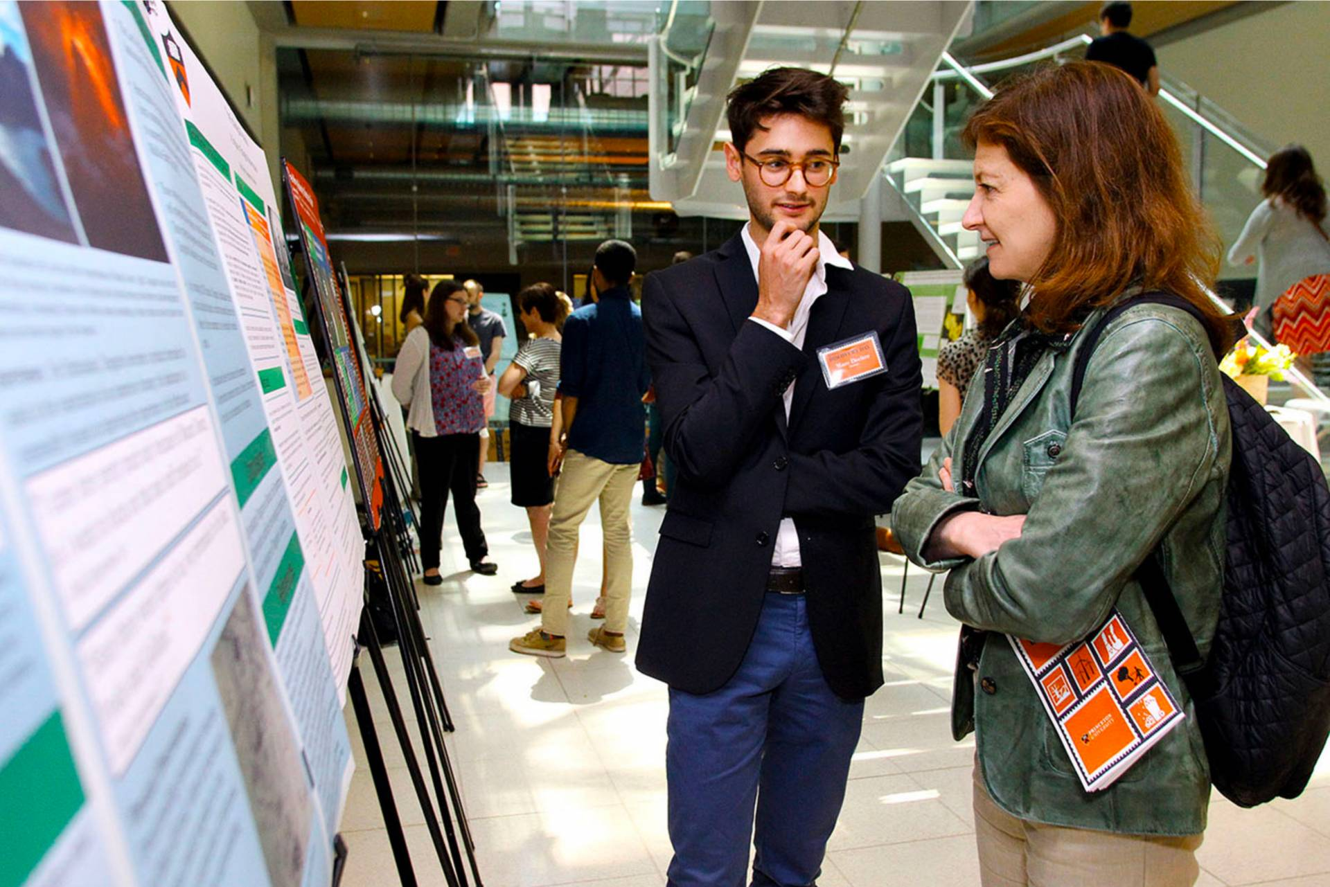 Marc Decitre explains his research to Princeton University Provost Deborah Prentice
