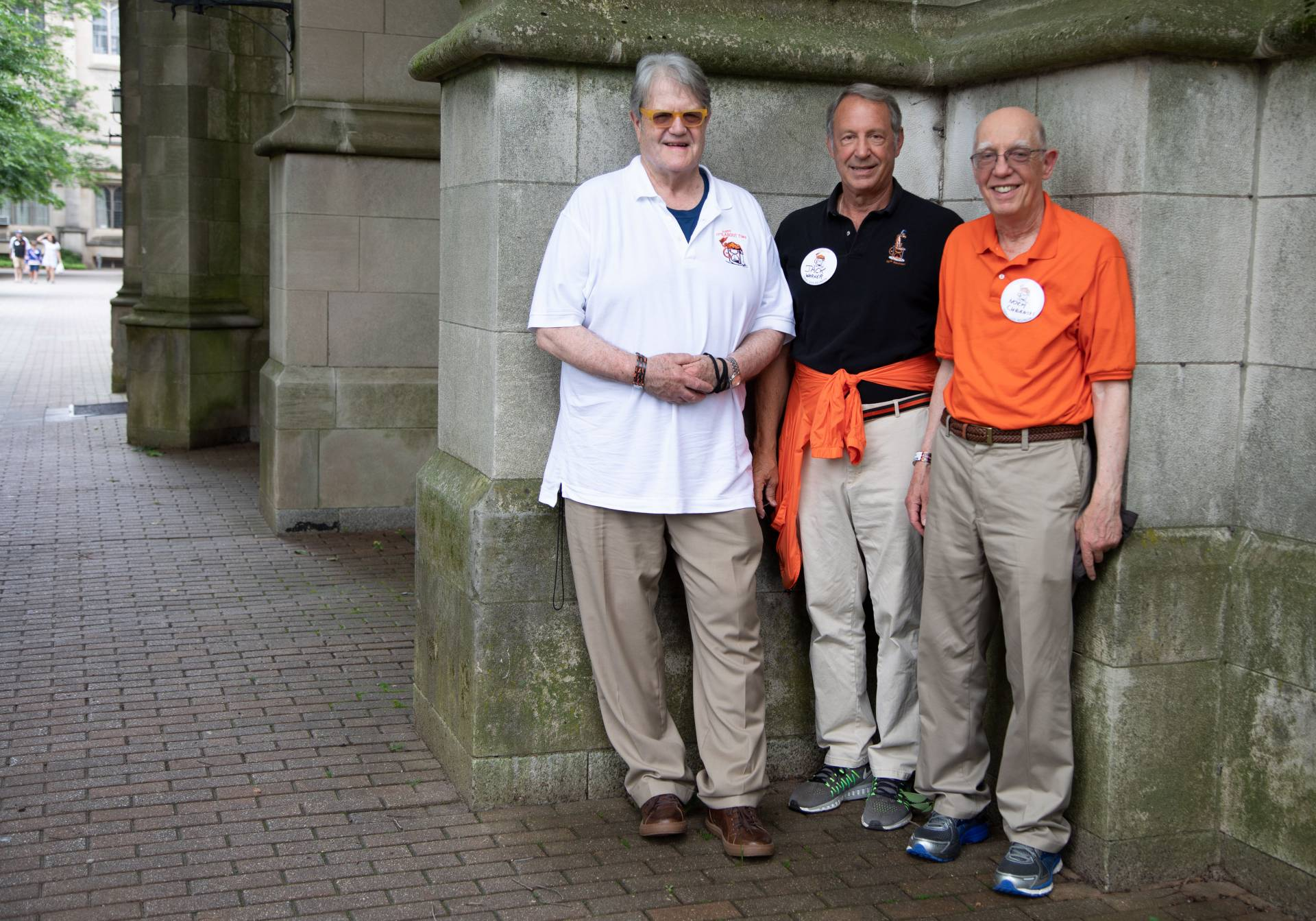 Ed Cadman '68, Jack Warner '68 and Norm Cubanski '68 standing outside McCosh
