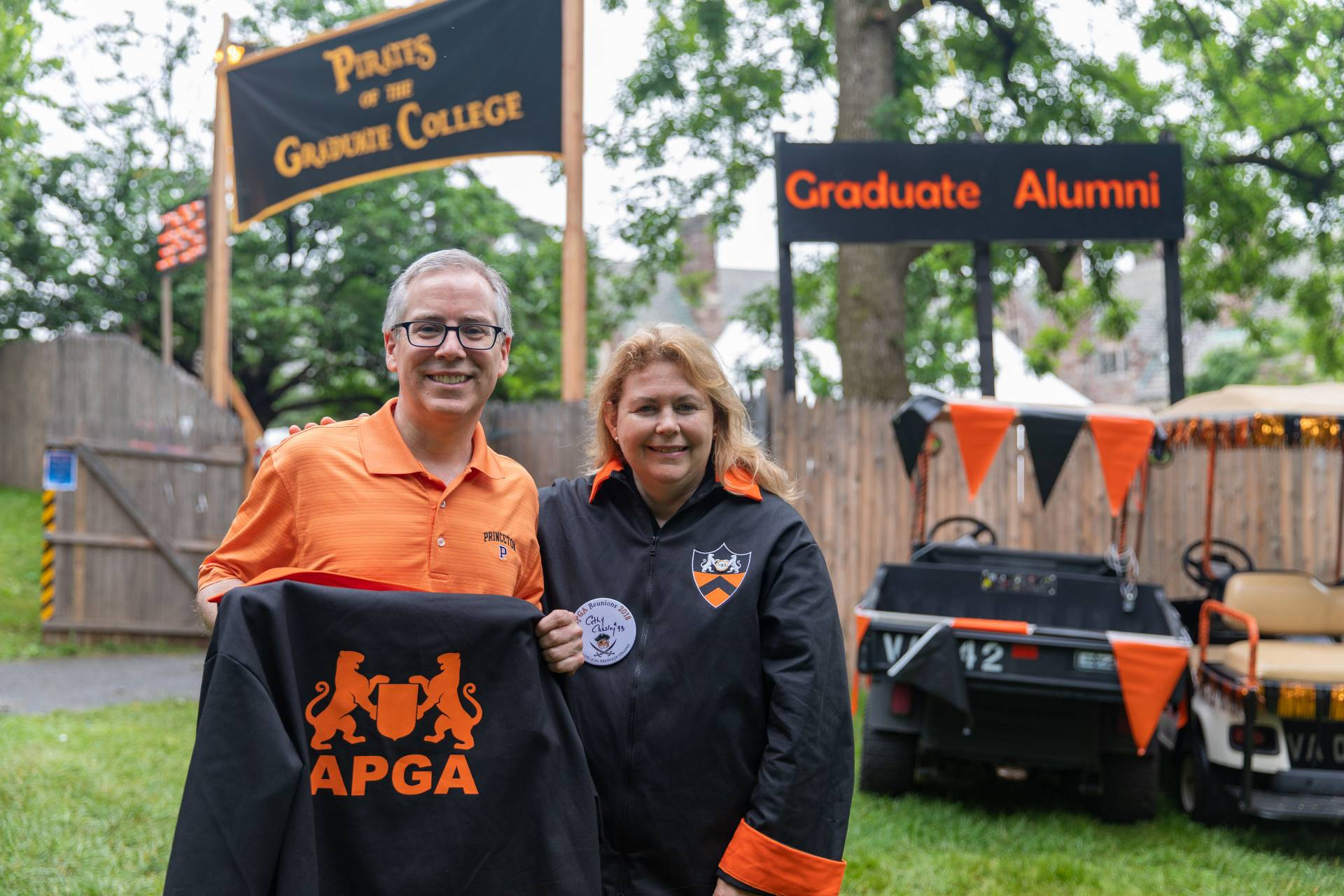 John Cuniff *88  and Cathy Carsley *93 standing outside Graduate Alumni reunion headquarters