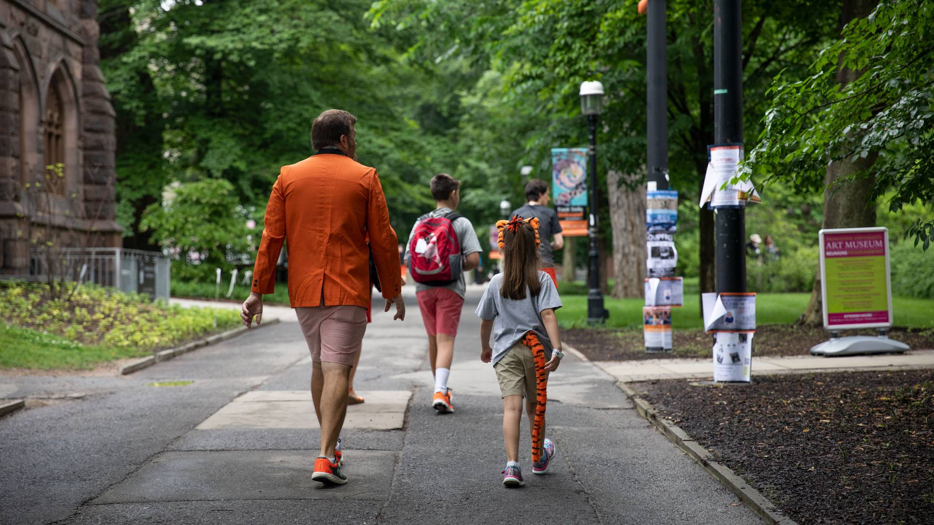Family walking on campus during reunions