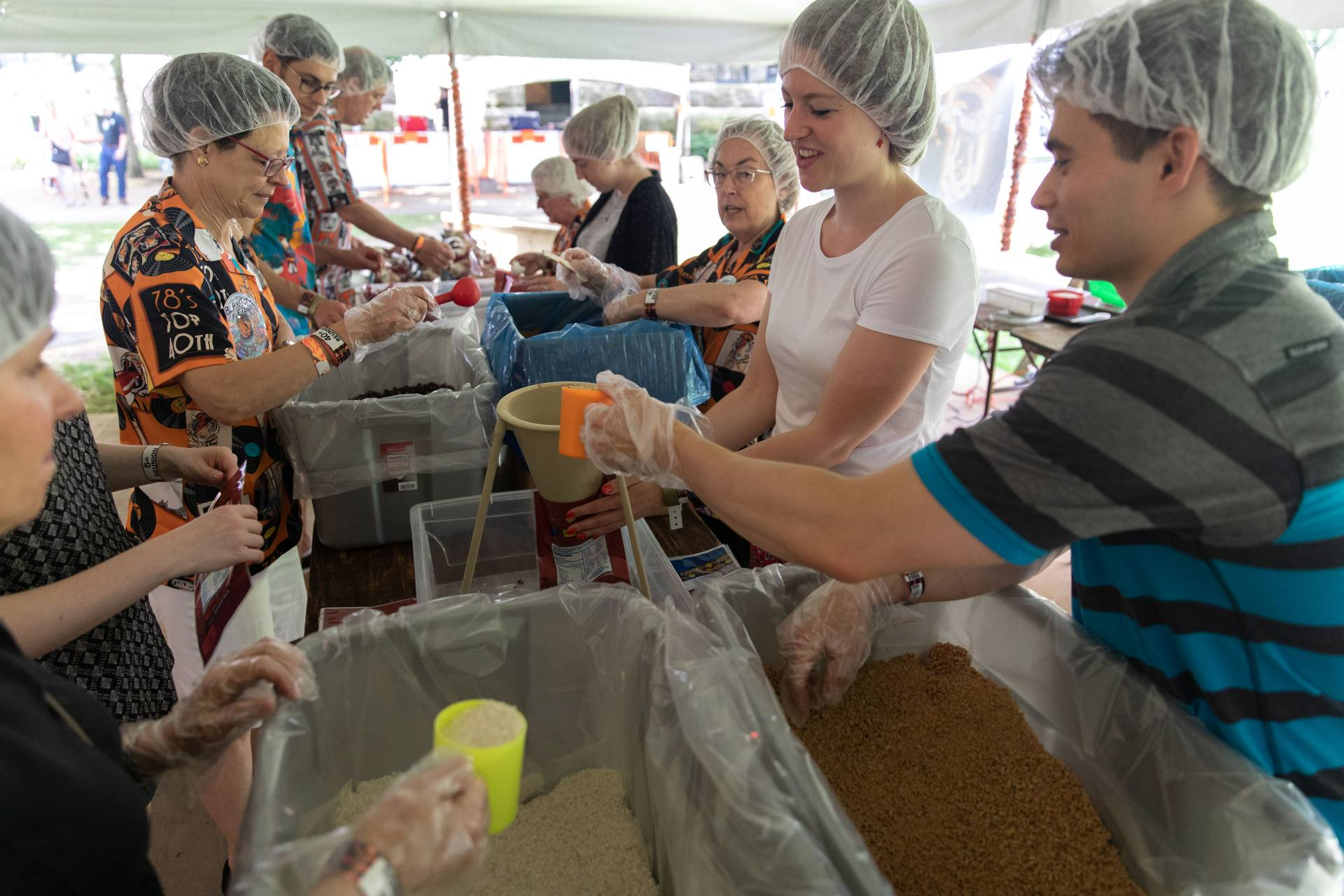 Alumni packing lunches for Kids Against Hunger during reunions