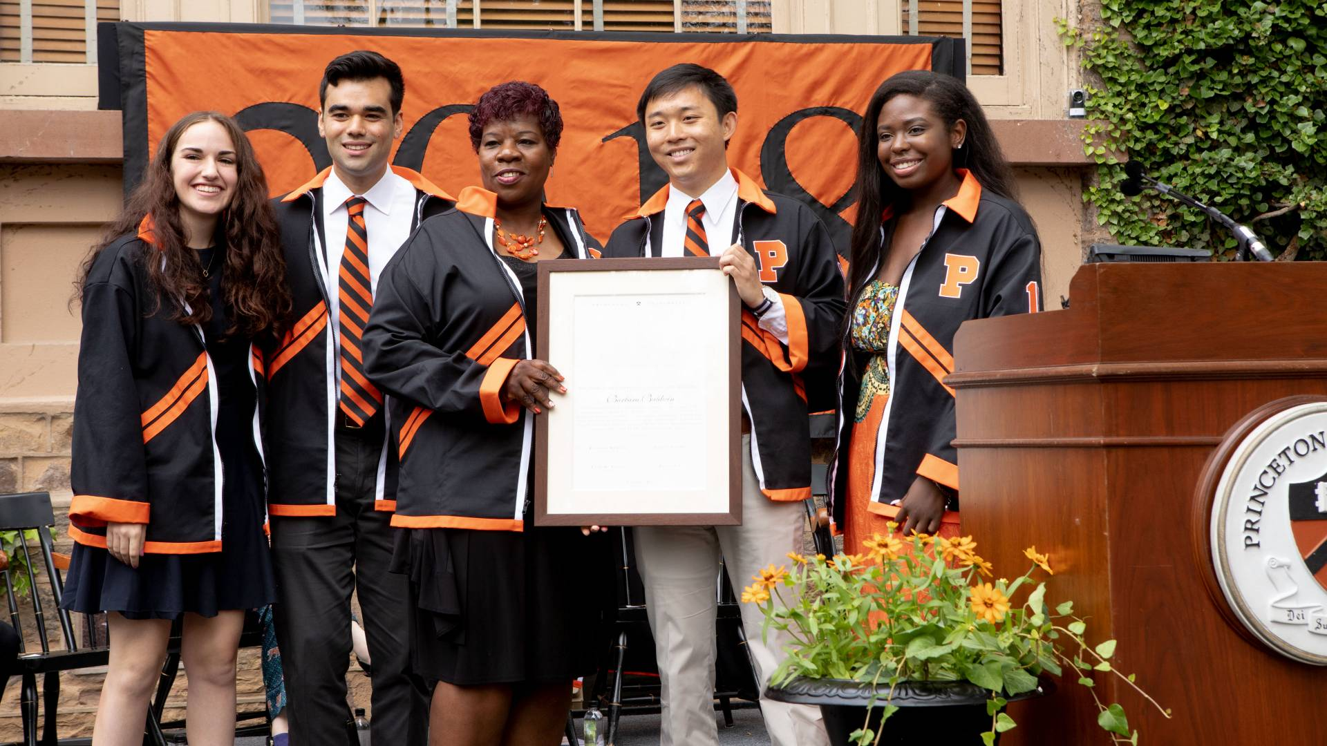 Barbara Baldwin receiving Class of 2018 Class Day jacket and certificate during Class Day ceremony