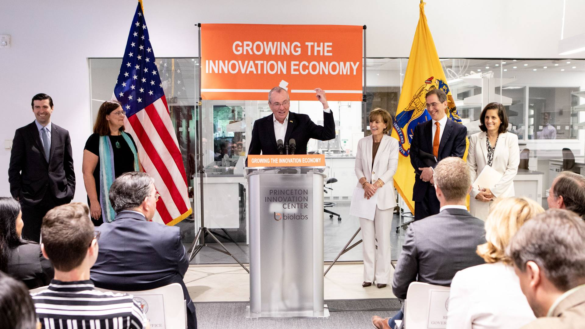 NJ Governor speaking at press conference at Princeton BioLabs