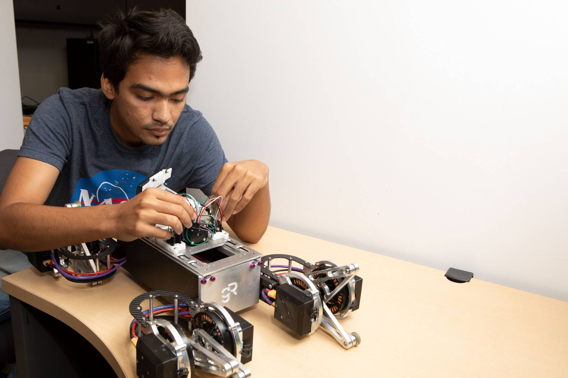 Sourish Ghosh working with robot