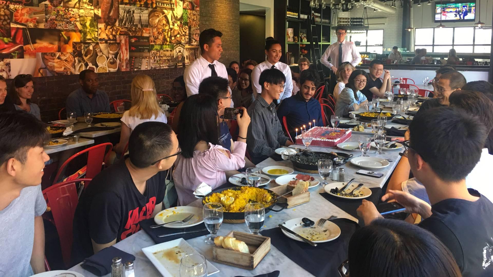 International students celebrating birthday at lunch