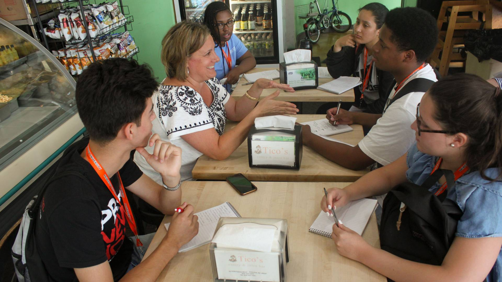 Students in Summer Journalism Program interview store owner