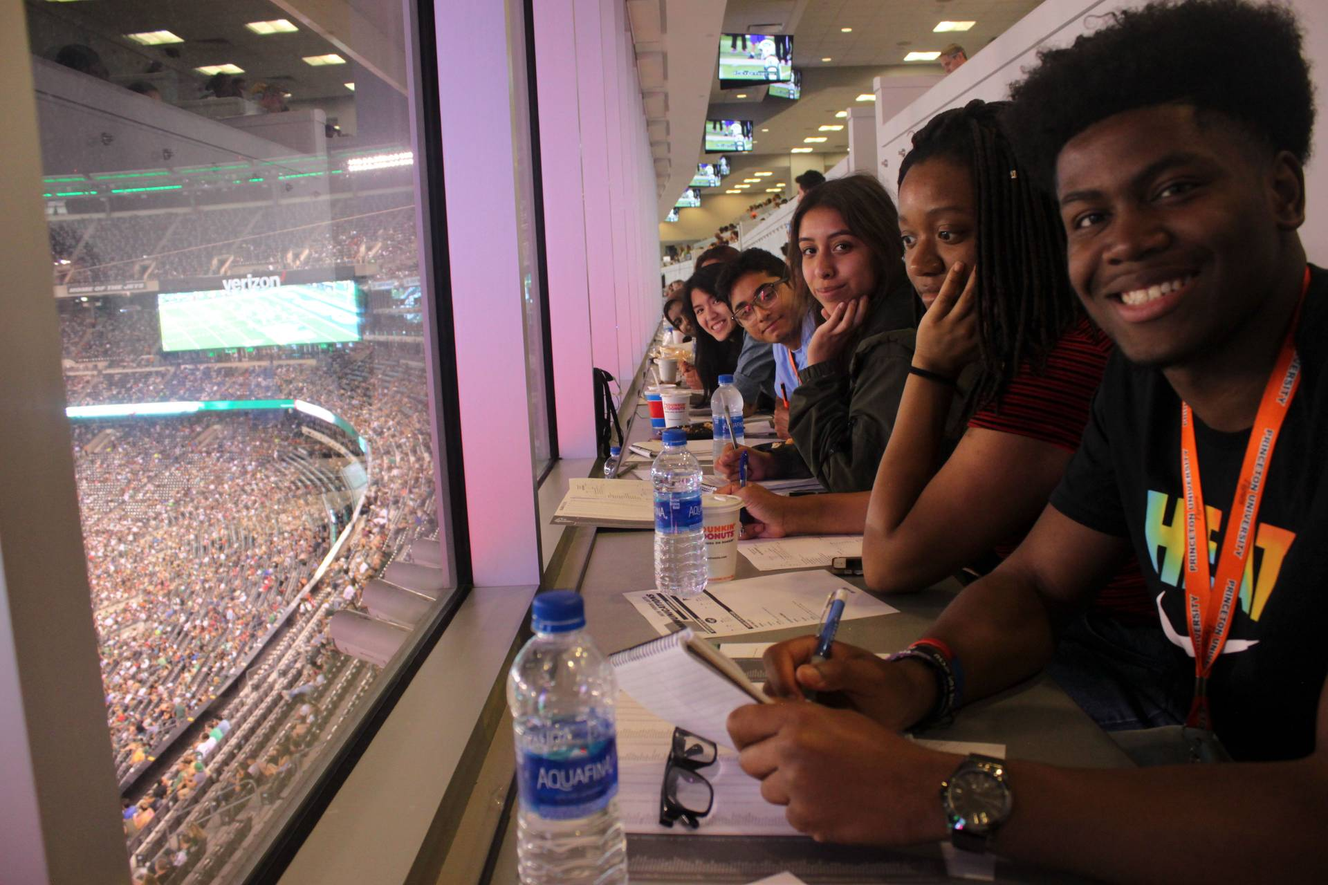 Summer Journalism Program students in press box during Jets football game