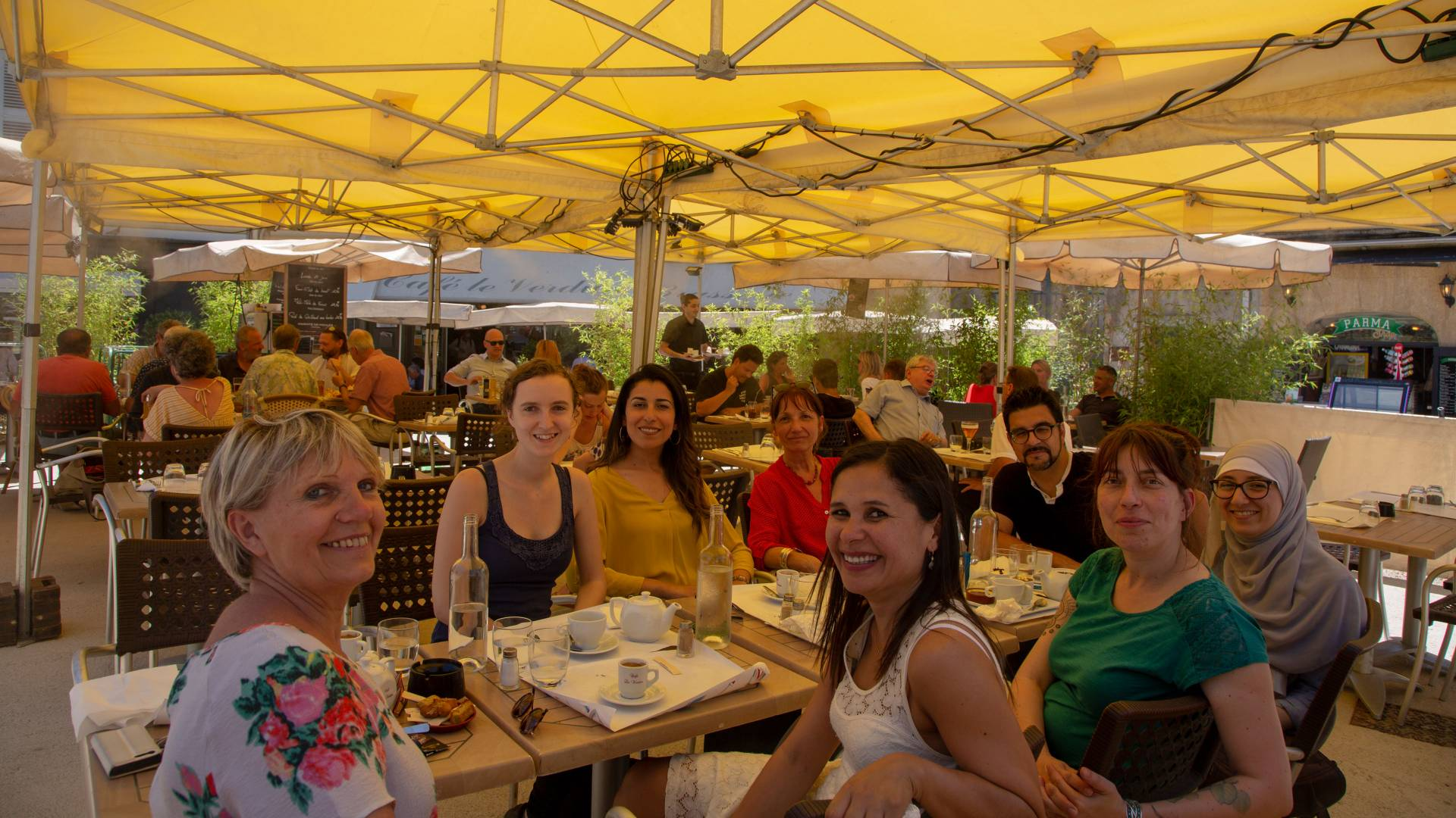 Faculty and graduate students sitting in outdoor cafe in France