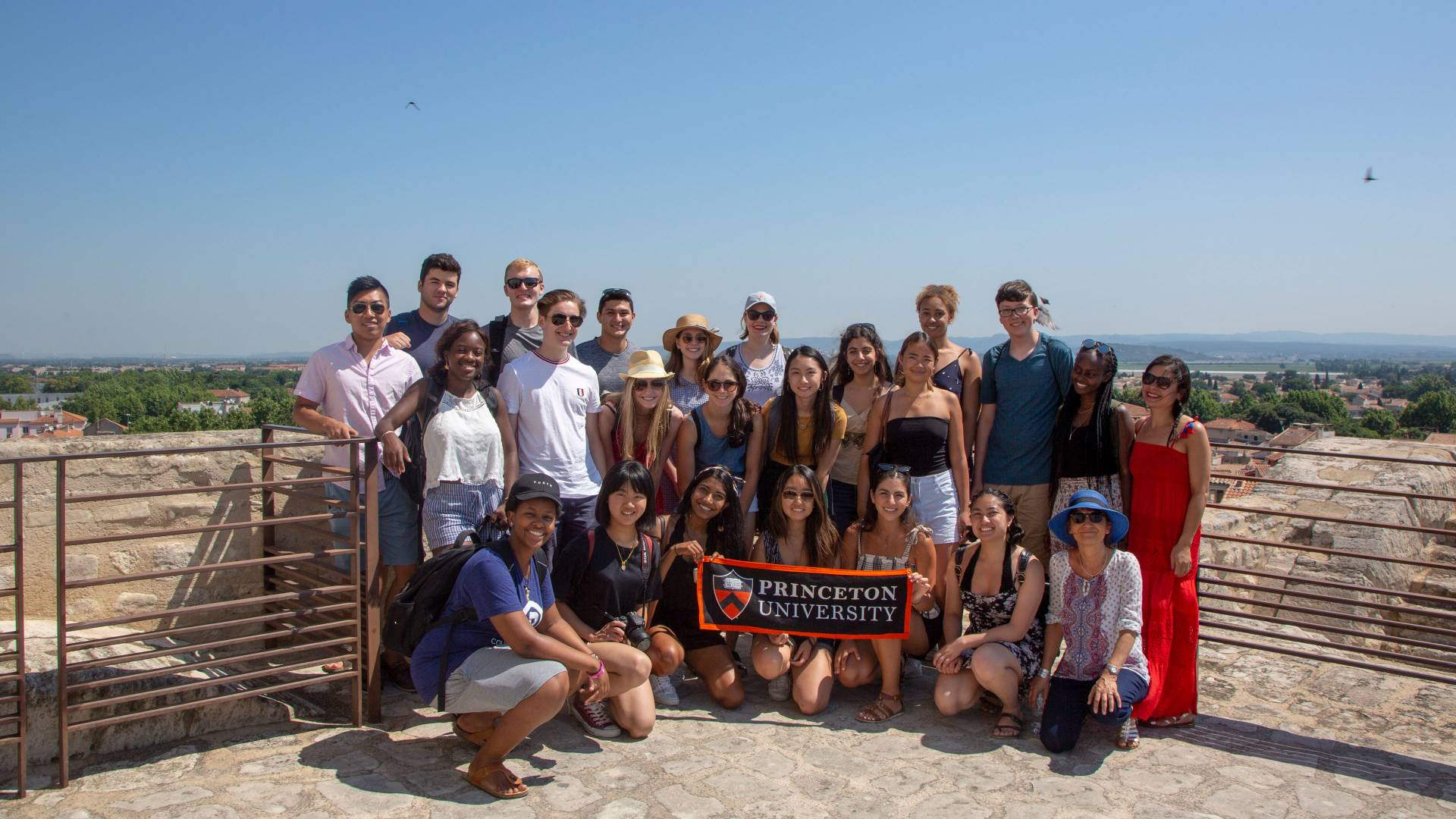 Students and faculty pose with Princeton University banner in France