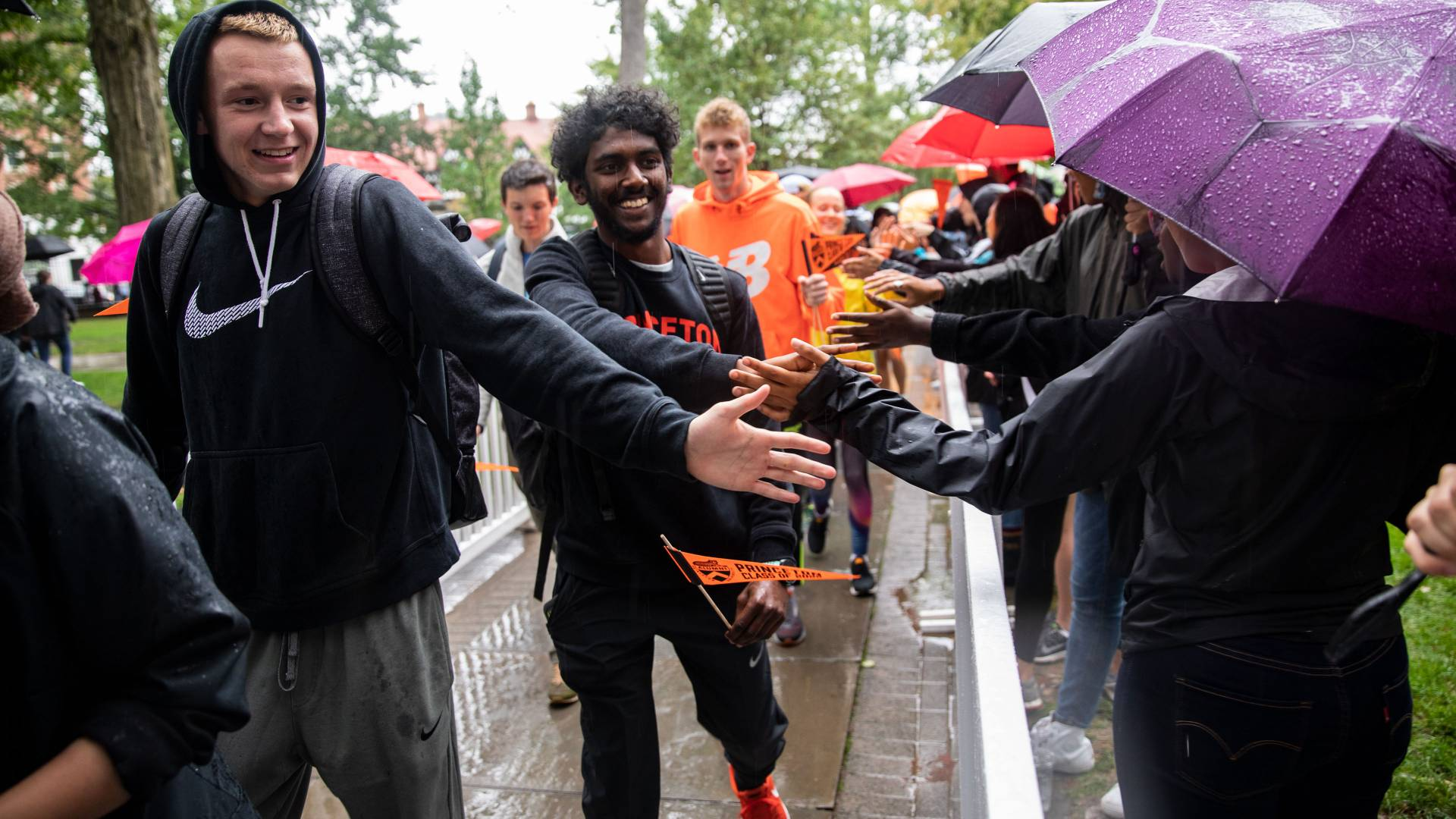 Students high-fiveing during Pre-rade