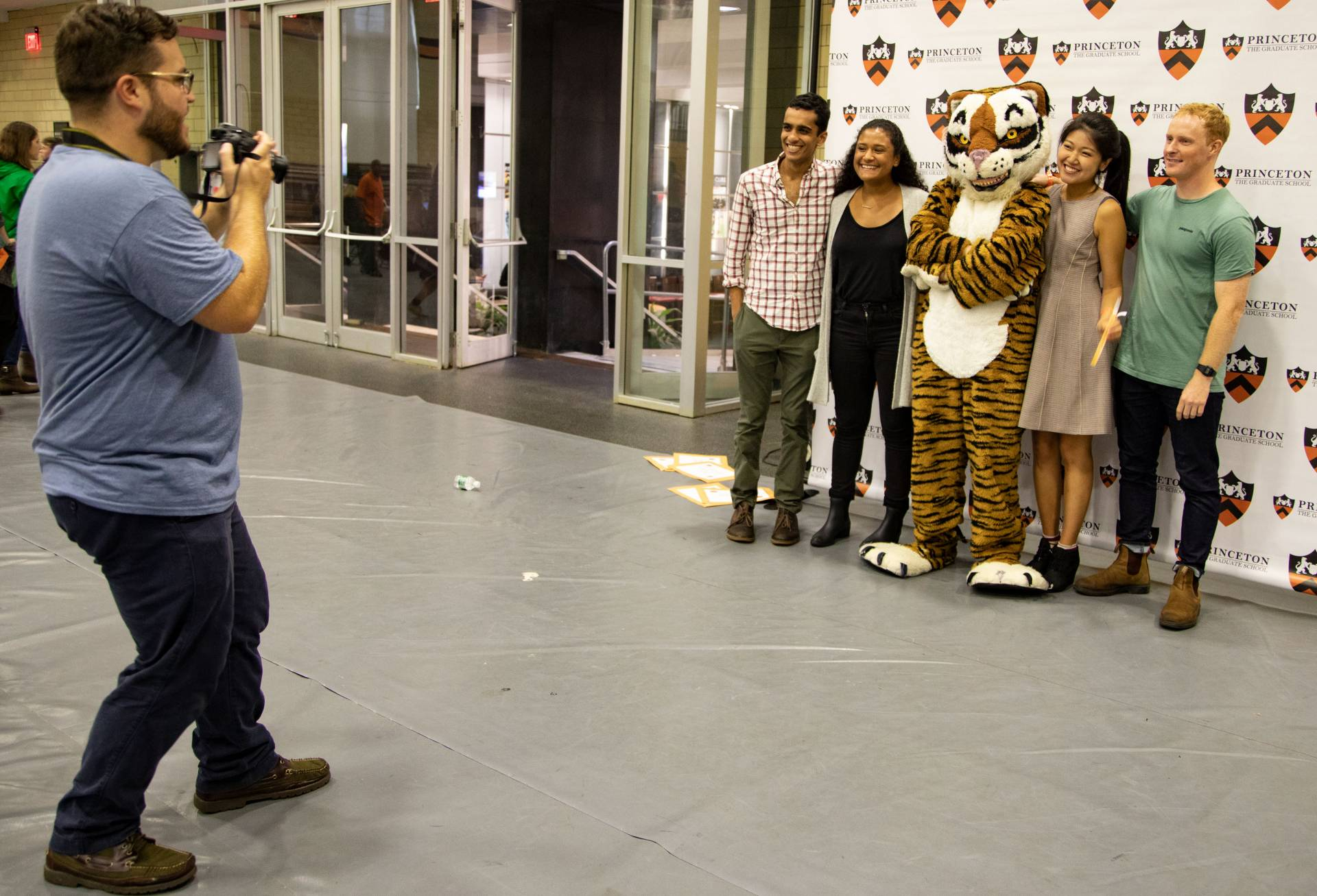 Graduate students posing with Princeton tiger mascot