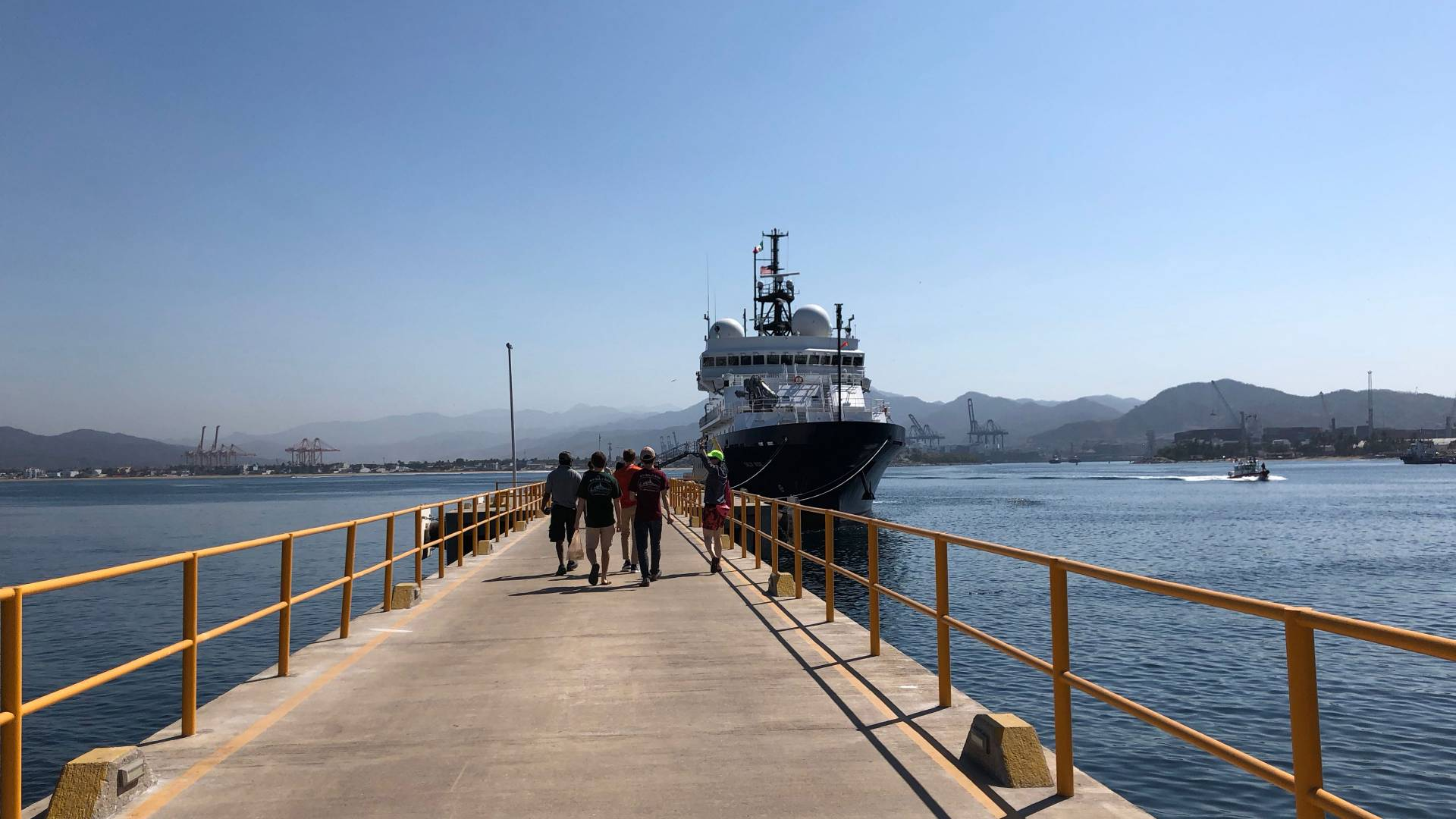 Scientists walking back to the research vessel Sally Ride at the dock in Manzanillo, Mexico