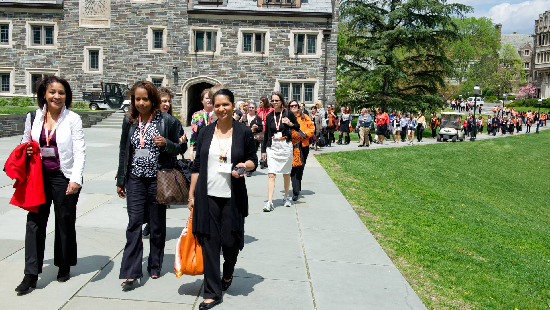 Alumnae walking down the hill from Whitman College