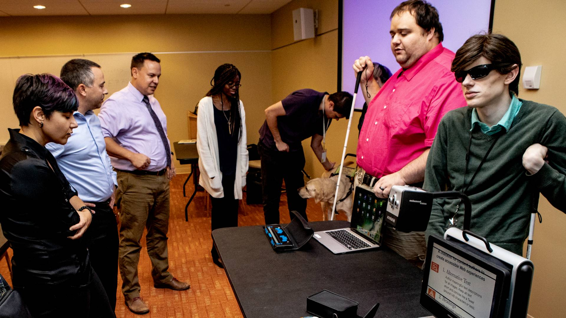 Representatives of the New Jersey Commission for the Blind and Visually Impaired demonstrate special screen readers for people with visual impairments