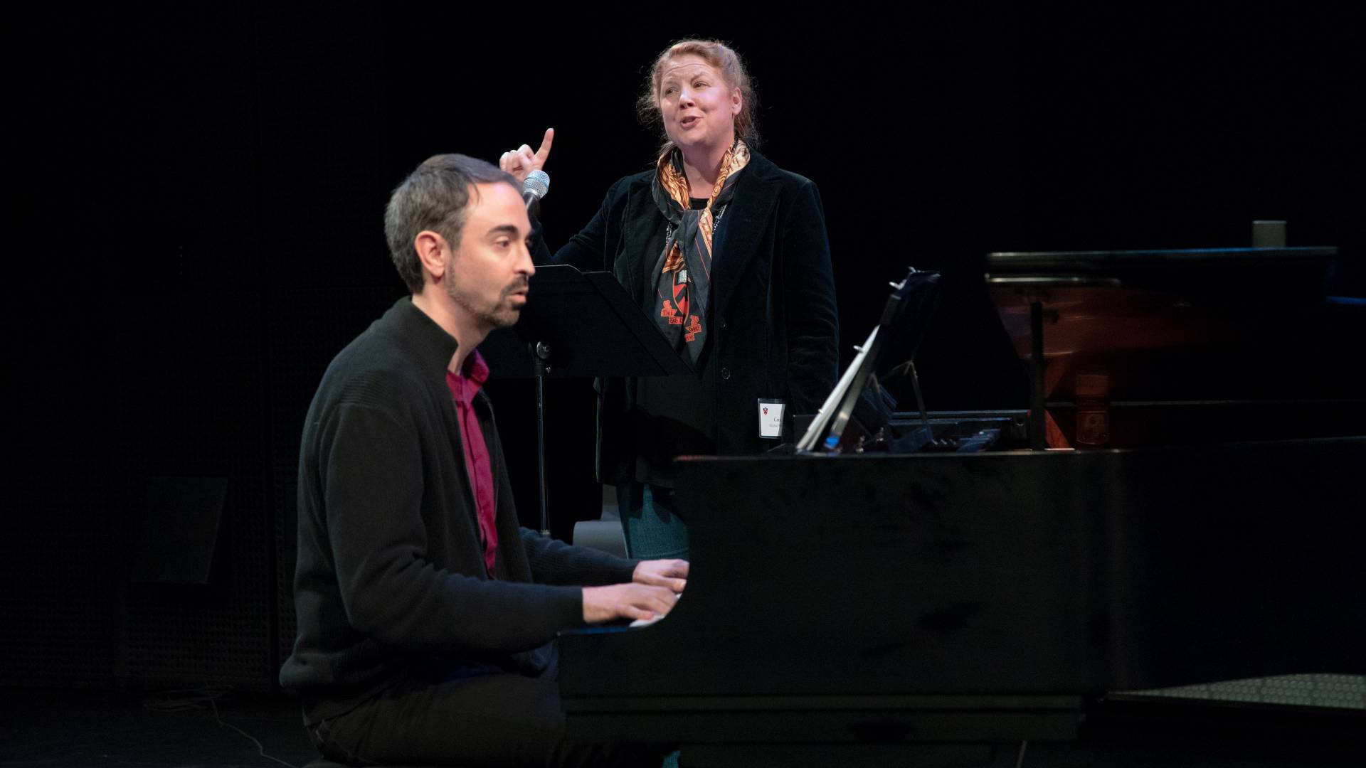 Cara Reichel singing and Peter Mills at the piano