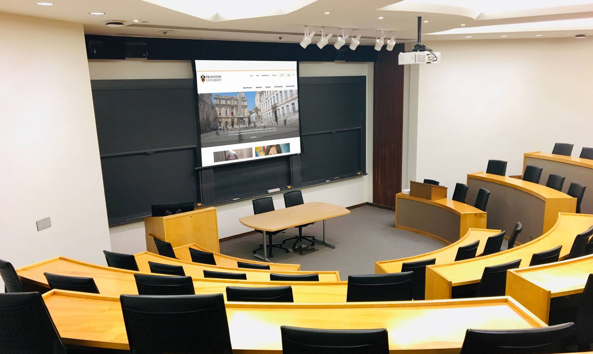Large empty classroom with projector screen