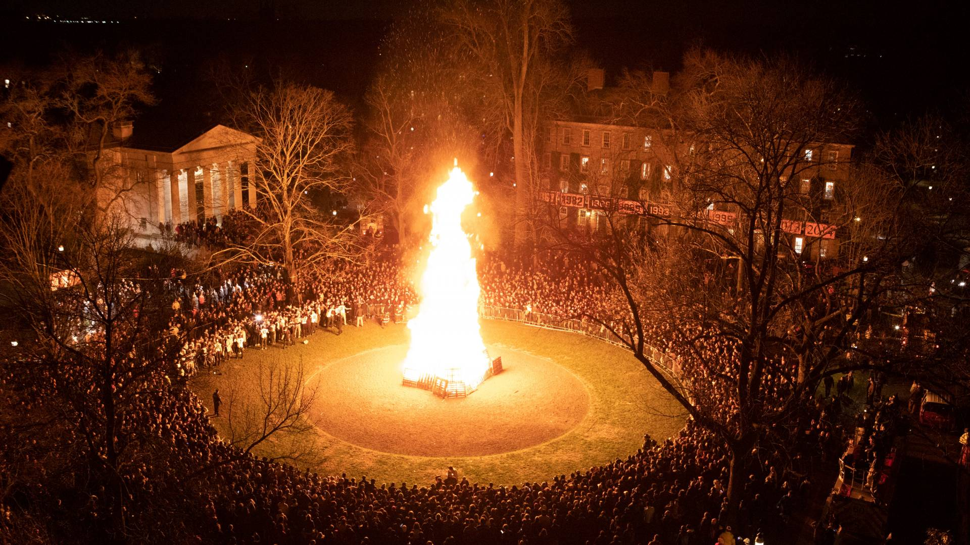 The bonfire from afar with thousands of students gathered around it